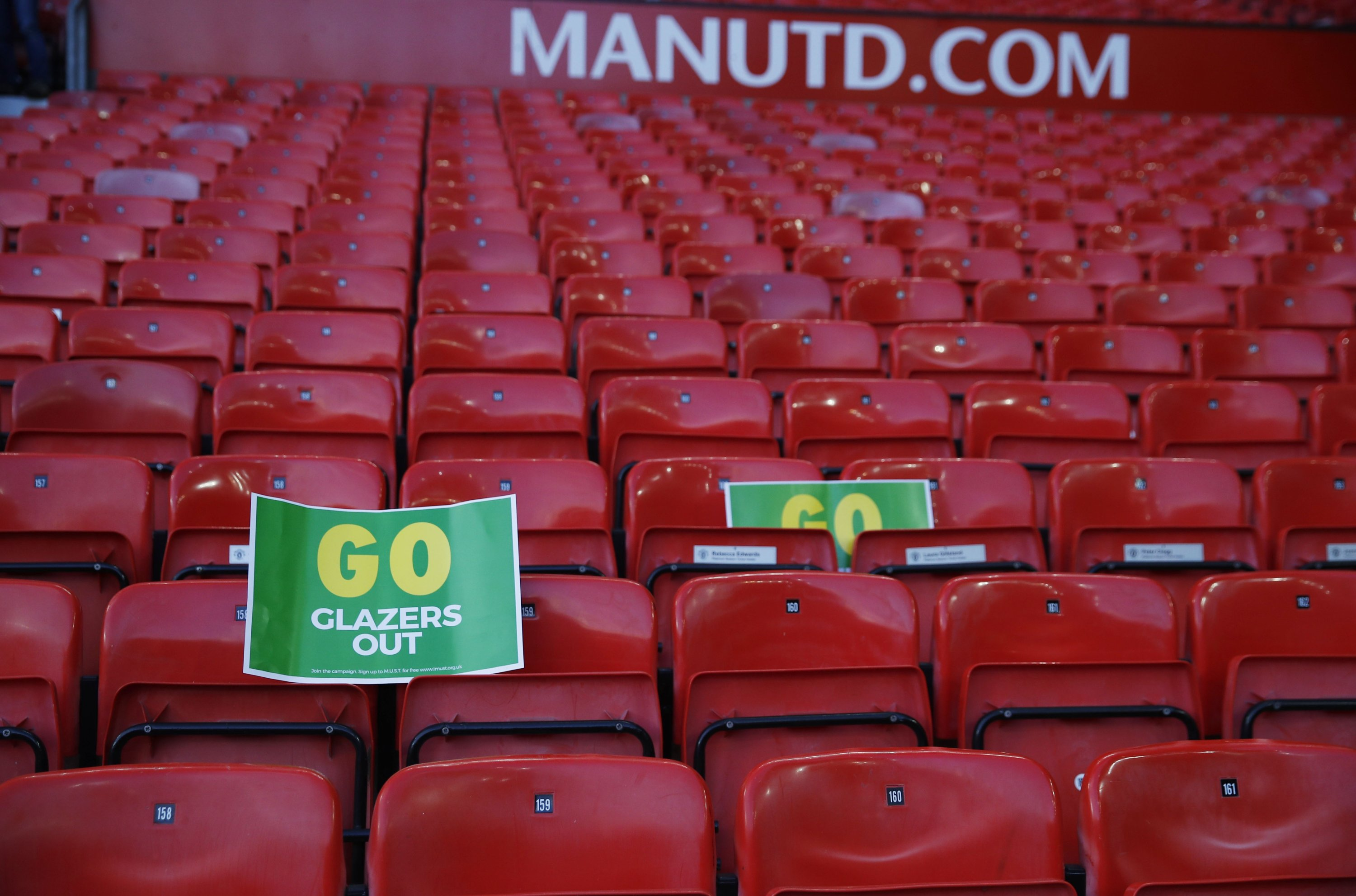 A  'Go Glazers Out' sign is attached to the stands after the Premier League match between Manchester United and Fulham at Old Trafford, Manchester, Britain, May 18, 2021. (Reuters Photo)