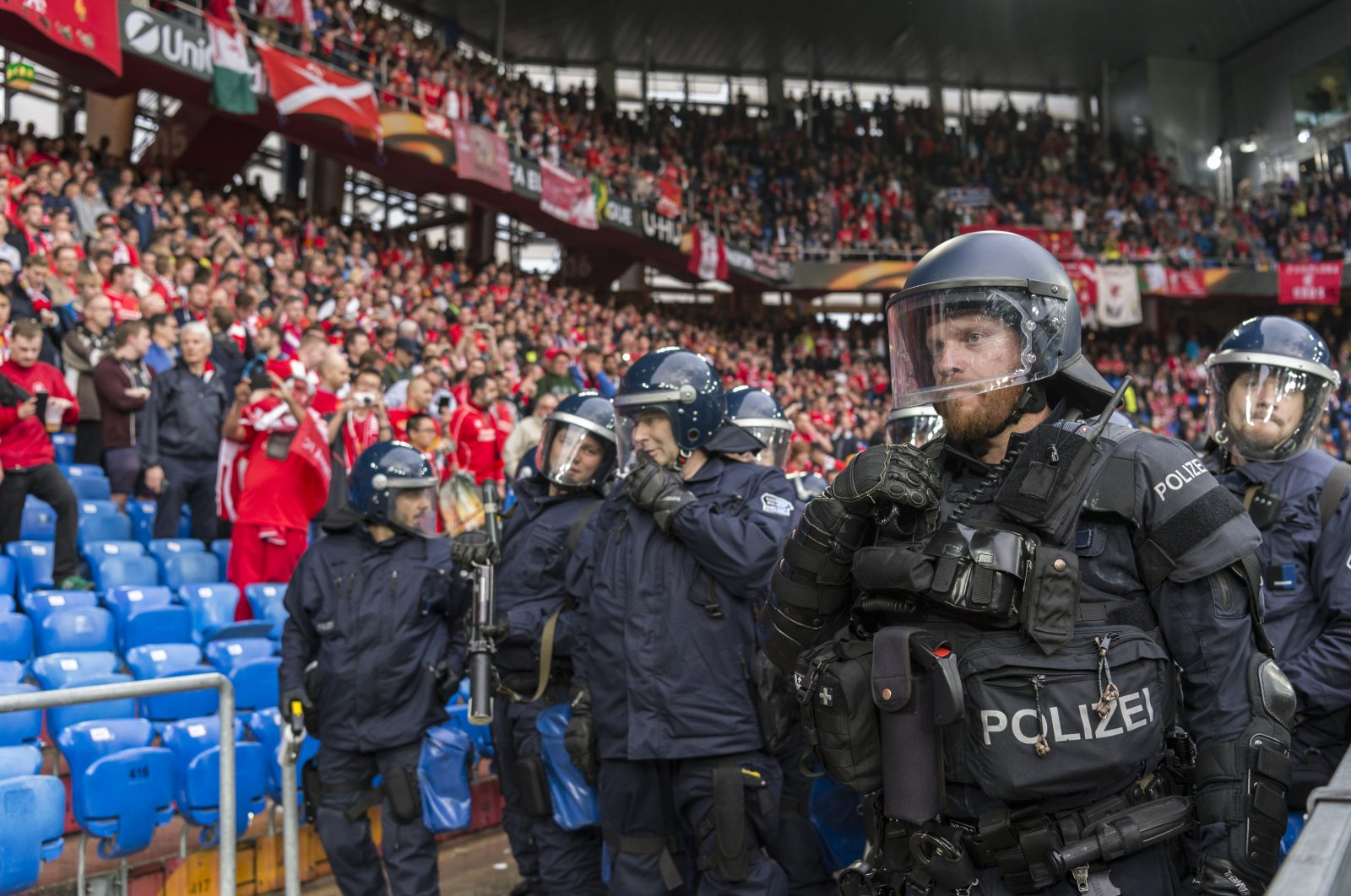 Riot police move into position ahead of the Europa League final between England's Liverpool FC and Spain's Sevilla Futbol Club at the St. Jakob-Park stadium in Basel, Switzerland, May 18, 2016. (AP Photo)