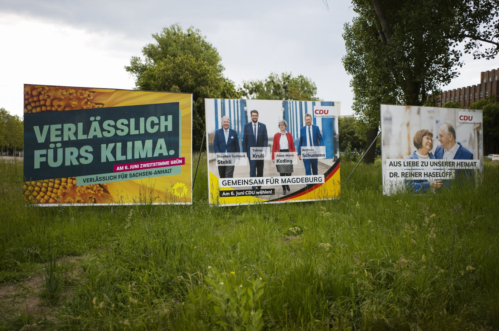 Election campaign posters from the Greens and Merkel's Christian Democratic Union party stand near a road in the federal state Saxony-Anhalt's capital Magdeburg, Germany, Wednesday, June 2, 2021. (AP Photo)