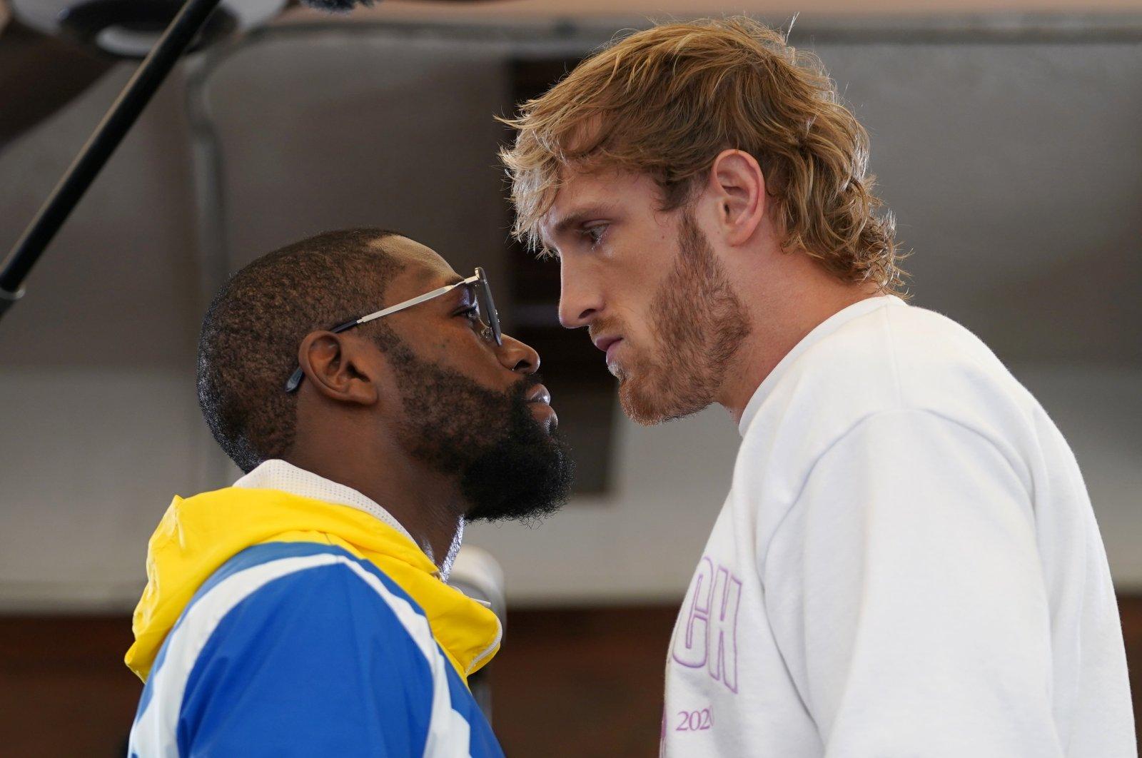 Former boxing world champion Floyd Mayweather (L) and YouTube star Logan Paul face off at Villa Casa Casuarina, Miami, U.S., June 3, 2021. (Reuters Photo)