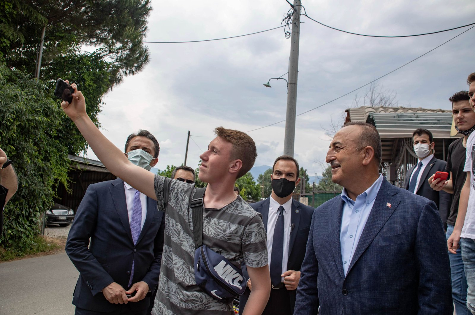 Foreign Minister Mevlüt Çavuşoğlu (R) pauses for a selfie during his official visit to Komotini (Gümülcine), Greece, May 30, 2021. (Photo by Getty Images)