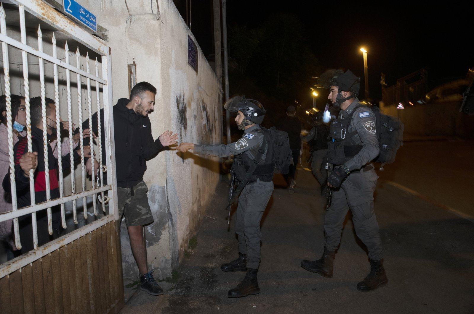 Israeli border police confront residents at their home in the Sheikh Jarrah neighborhood of East Jerusalem, where several Palestinian families face imminent eviction, Palestine, May 12, 2021. (AP Photo)