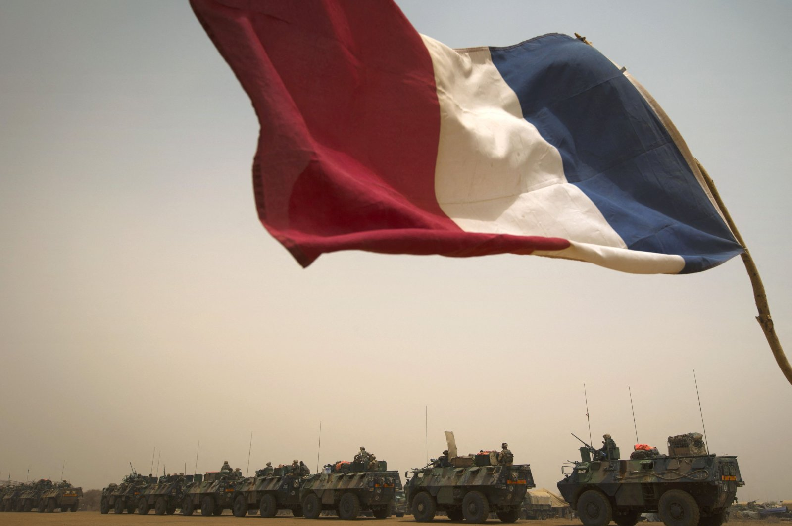 """French armored personnel carriers (VAB) leave the city of Gao during the """"Gustav operation,"""" Mali, April 6, 2013. (AFP Photo)"""
