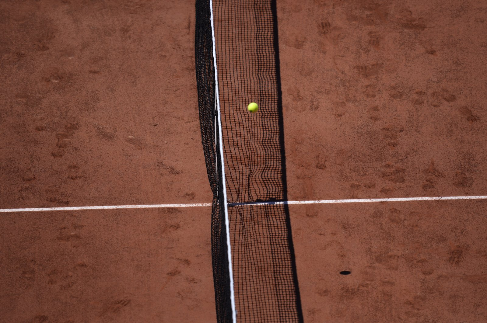 The ball passes over the net during a French Open tennis match at the Roland Garros stadium, Paris, France, May 30, 2021.(AP Photo)