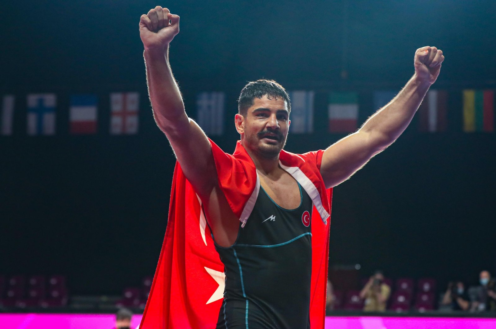 Turkish wrestler Taha Akgül celebrates winning the 125-kg gold medal match against Russia's Sergei Kozyrev at the 2021 European Wrestling Championships, in Warsaw, Poland, May 21, 2021. (AA Photo)
