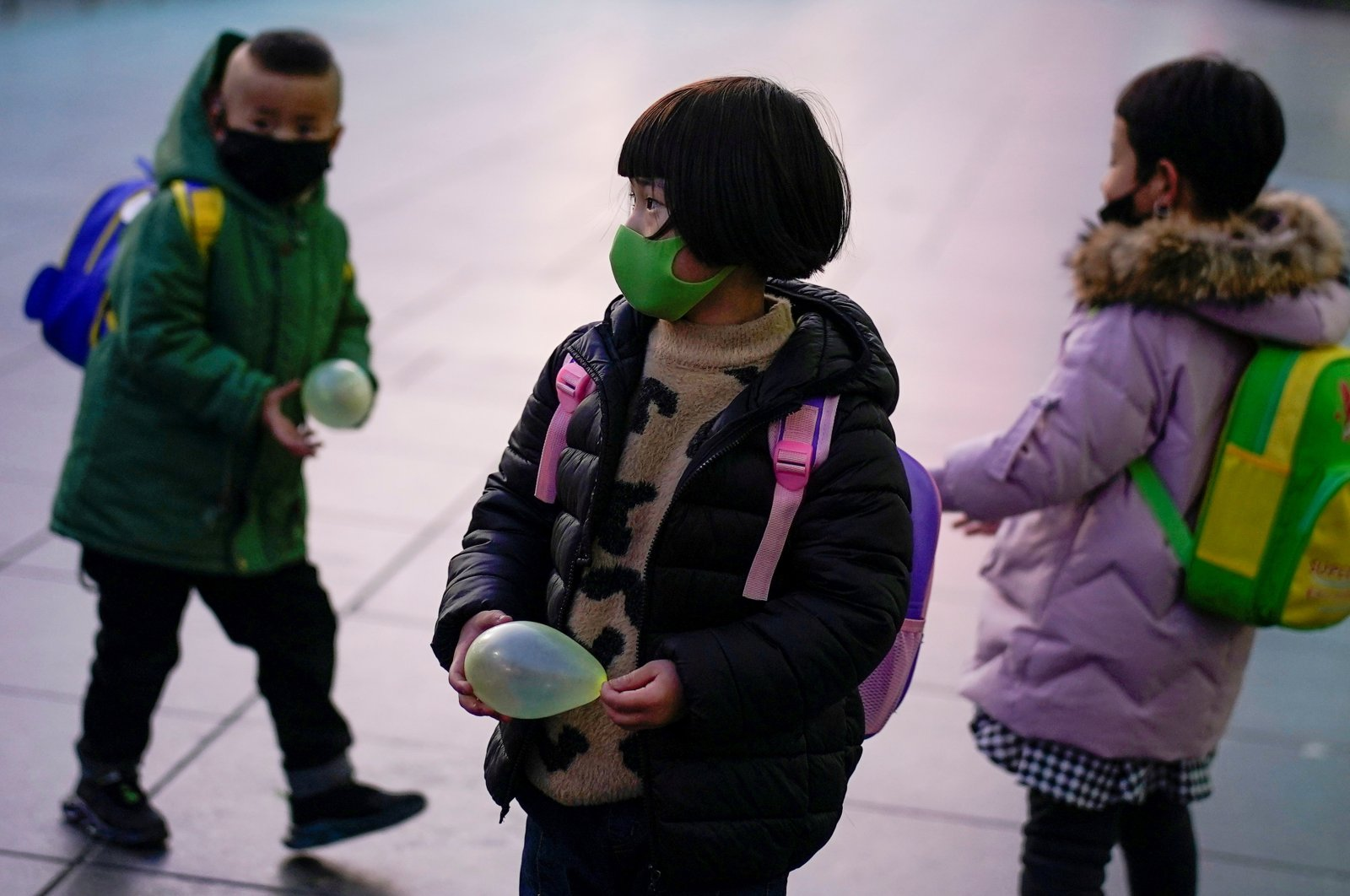 Children wearing face masks are seen at Shanghai railway station, Shanghai, China March 5, 2020. (Reuters Photo)