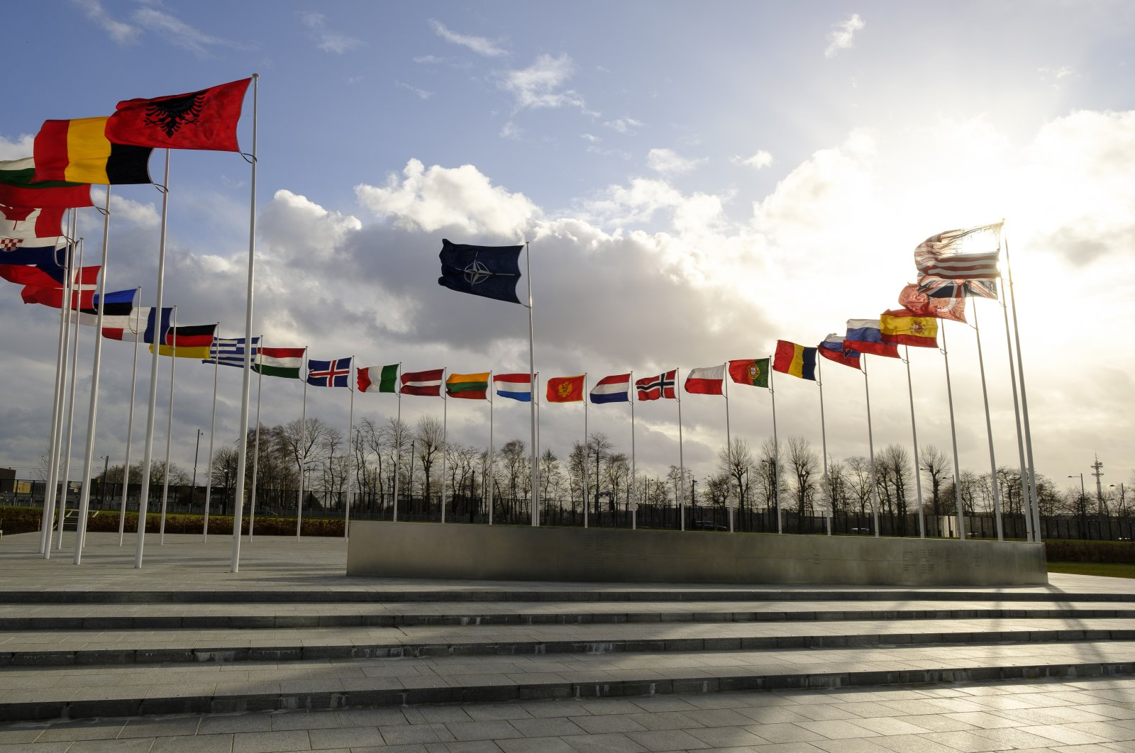 Flags line the sidewalk near the NATO headquarters in Brussels, Belgium, Feb. 11, 2020. (Photo by Getty Images)