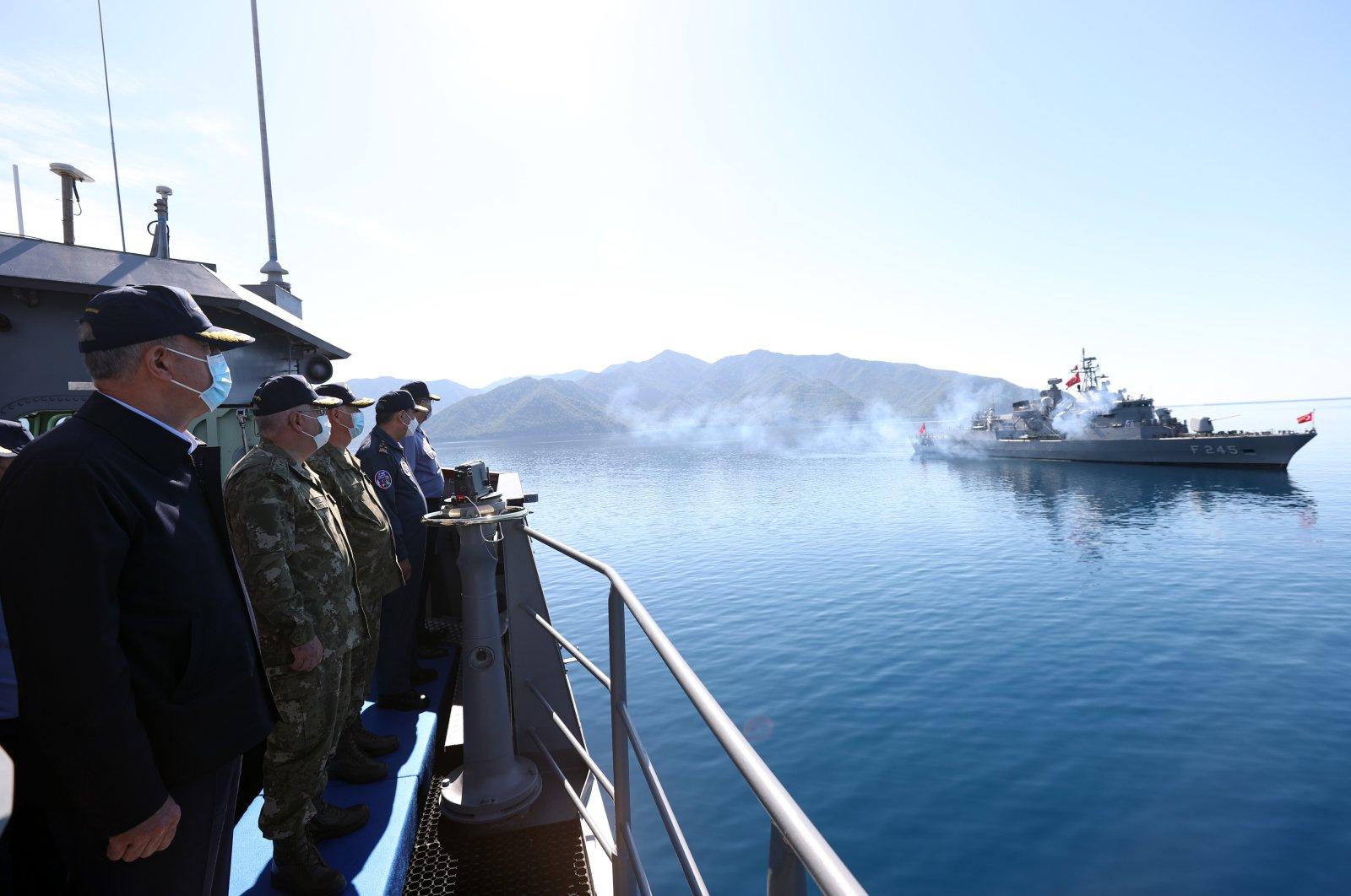 Turkish Defense Minister Hulusi Akar and the command echelon of the Turkish Armed Forces (TSK) observe the Sea Wolf (Denizkurdu) military drill off Marmaris, Muğla, Turkey, June 4, 2021. (AA Photo)