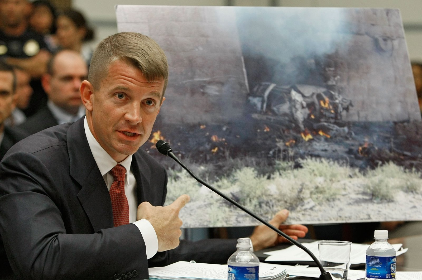 Erik Prince, chairperson of the Prince Group, LLC and Blackwater, holds up a picture showing the affect of a car bomb while testifying during a House Oversight and Government Reform Committee hearing on Capitol Hill, Oct. 2, 2007 in Washington D.C., U.S. (Getty Images)