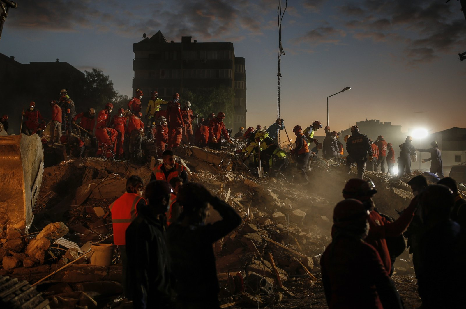 Members of rescue services search for survivors in the debris of a collapsed building in Izmir, Turkey, Nov. 2, 2020. (AP Photo)