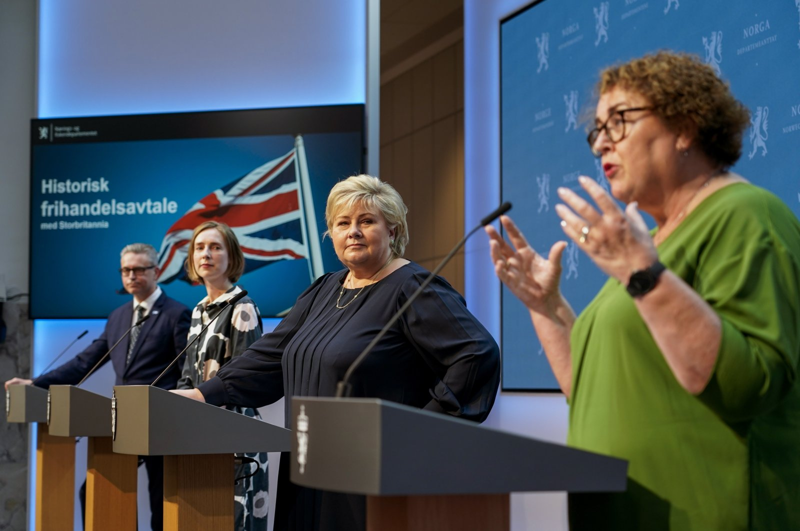 From left, Norway's Minister of Fisheries and Seafood Odd Emil Ingebrigtsen, Minister of Trade and Industry Iselin Nybo and Prime Minister Erna Solberg listen to Minister of Agriculture and Food Olaug Bollestad, during a press conference on the status of free trade negotiations with the United Kingdom, Oslo, Norway, Friday, June 4, 2021. (AP Photo)