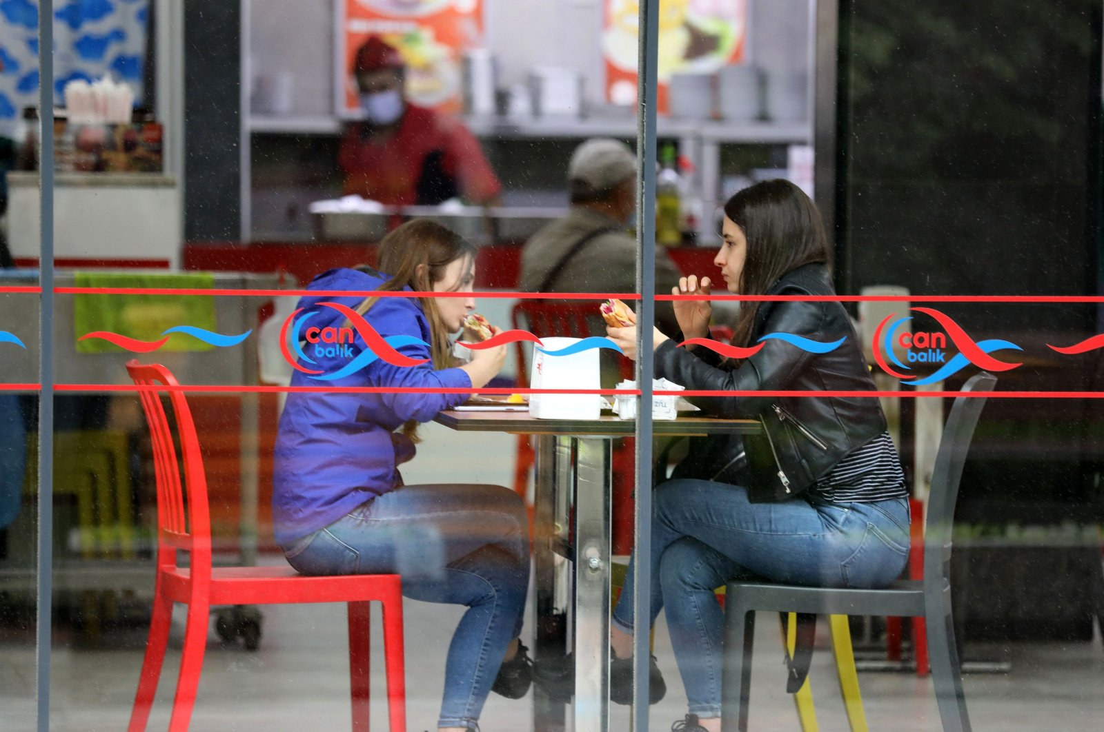 Customers eat at a reopened cafe in Ankara, Turkey, June 2, 2021. (AFP Photo)