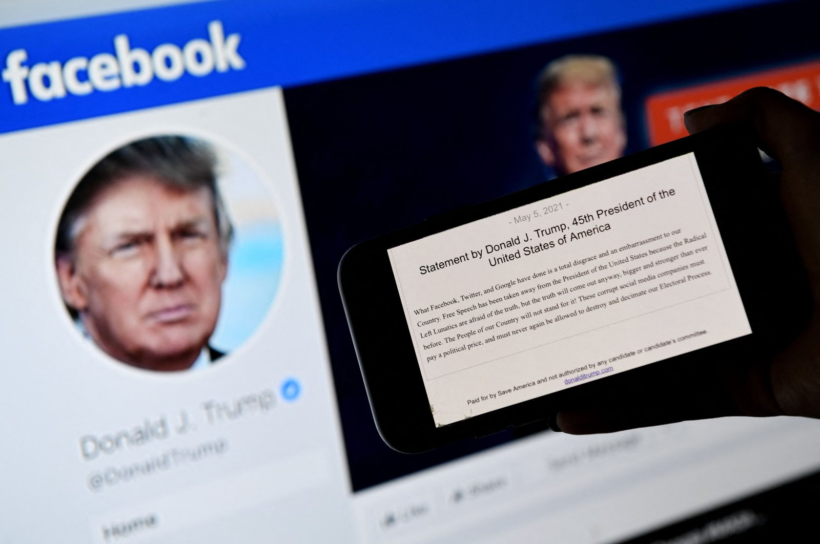 A phone screen displays the statement of former U.S. President Donald Trump in front of his Facebook page, in this photo illustration, Arlington, Virginia, U.S., May 5, 2021. (AFP Photo)