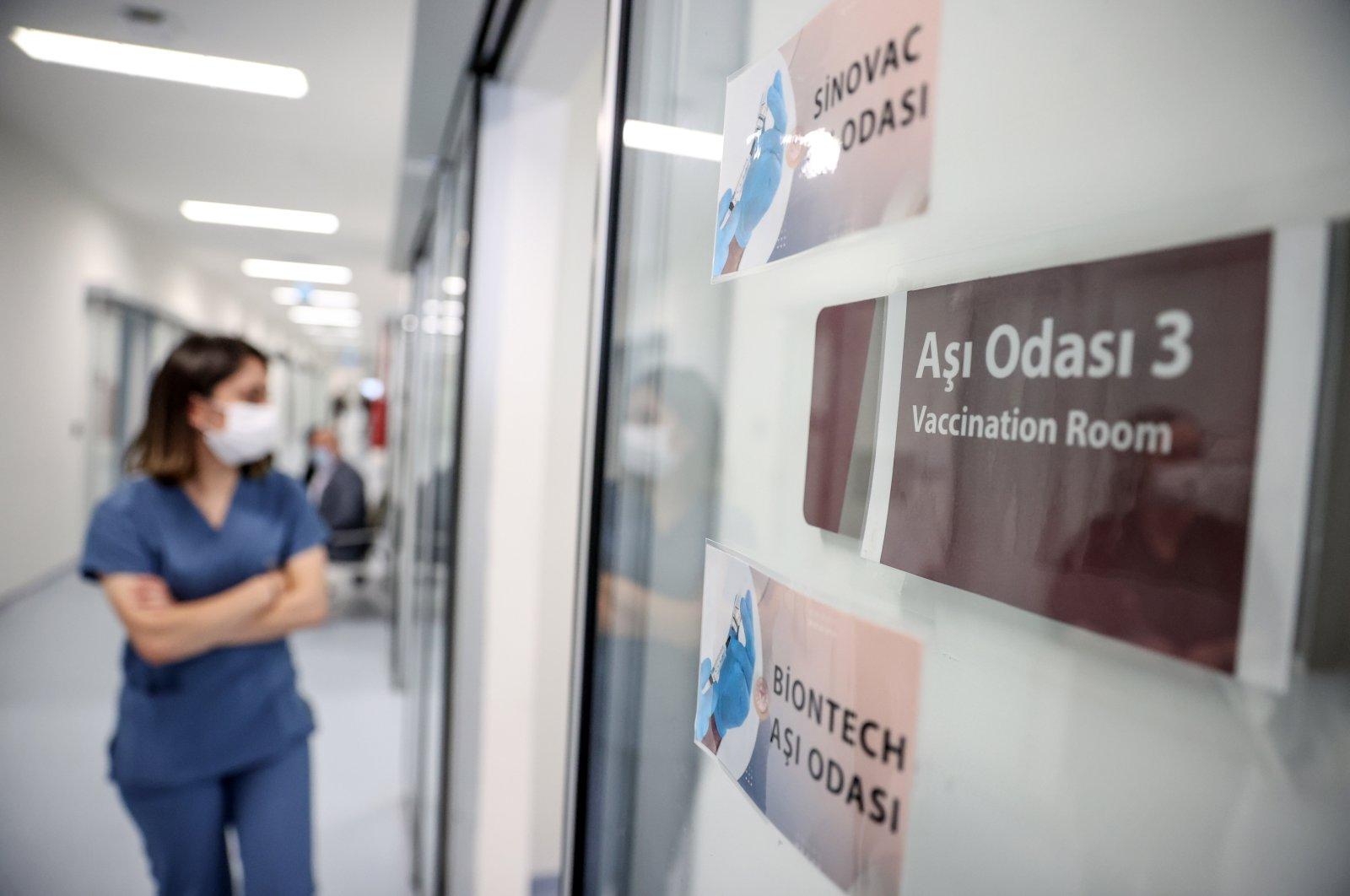 A nurse walks toward a vaccination room at the Prof. Dr. Feriha Öz Emergency Situation Hospital in Istanbul, Turkey, June 1, 2021. (AA Photo)