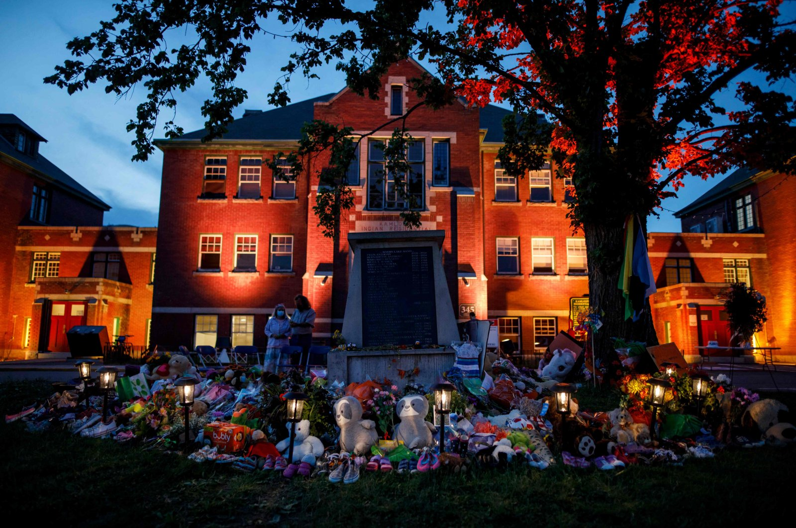 A makeshift memorial to honor the 215 children whose remains were discovered buried near the facility sits in front of the former Kamloops Indian Residential School in Kamloops, British Columbia, Canada, June 2, 2021. (AFP Photo)