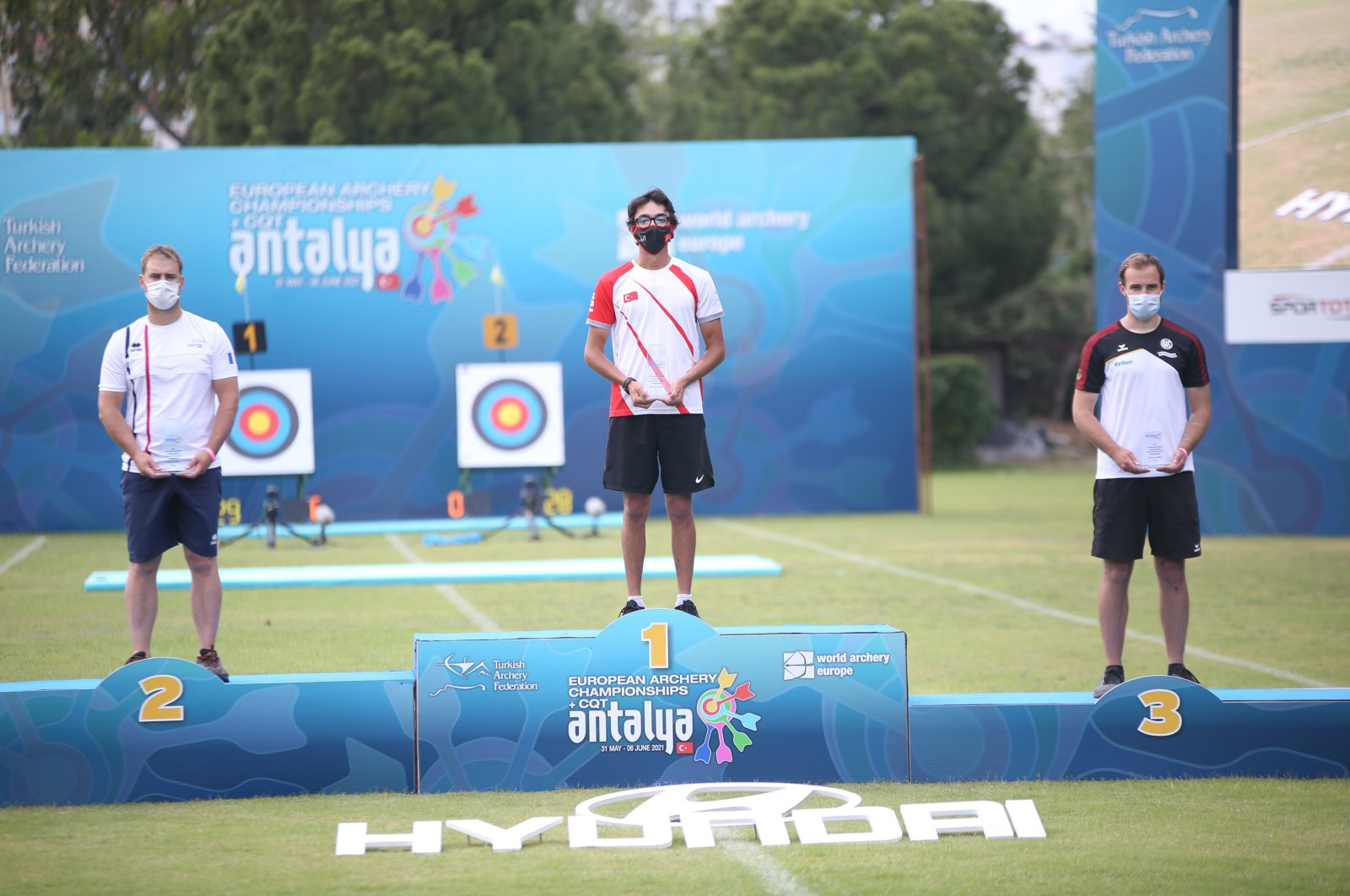Mete Gazoz (C) holds his gold medal after winning the European Archery Championships in Antalya, Turkey, June 4, 2021. (AA Photo)