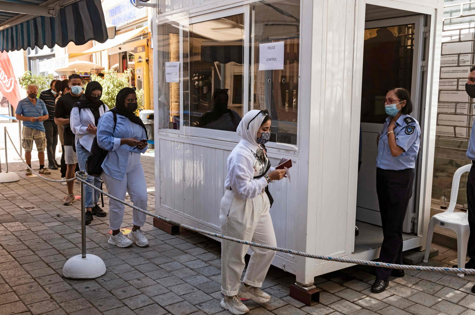 Following the easing of restrictions on the divided island amid the COVID-19 pandemic, people move through the Ledras crossing point from the southern Greek Cypriot administration toward the Turkish Republic of North Cyprus (TRNC), on June 4, 2021. (AFP Photo)