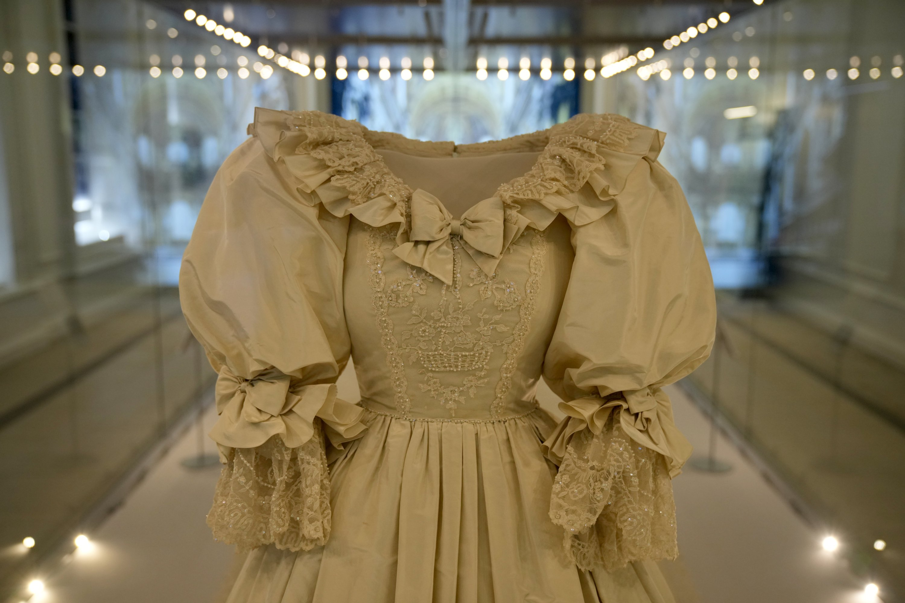 The wedding dress of Britain's Princess Diana is displayed during a media preview for the 'Royal Style in the Making' exhibition at Kensington Palace in London, U.K., June 2, 2021.  (AP Photo)