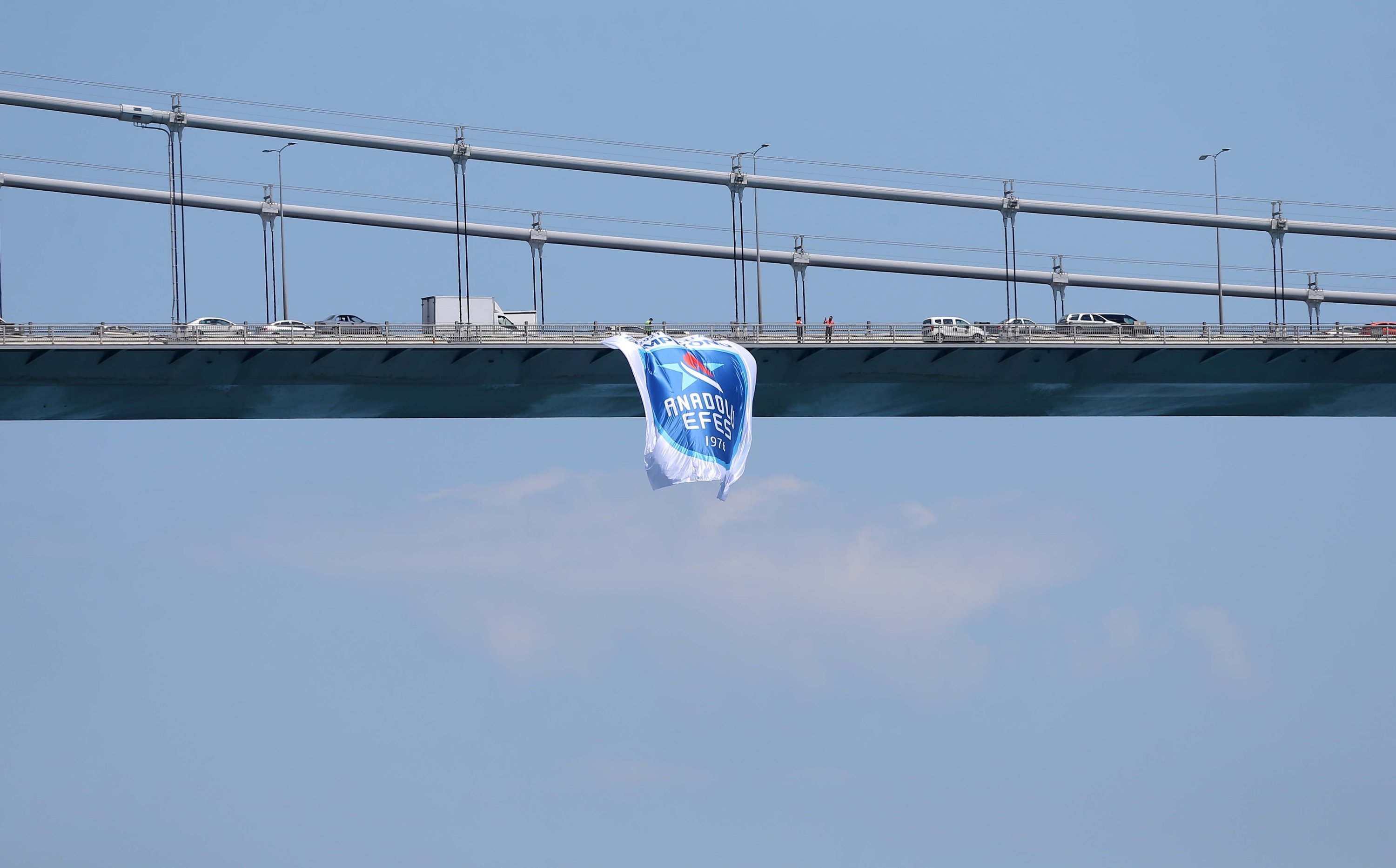 A flag of 2020-2021 EuroLeague champion Anadolu Efes is seen on the July 15 Martyrs' Bridge in Istanbul, Turkey, Saturday, June 6, 2021. (DHA Photo)