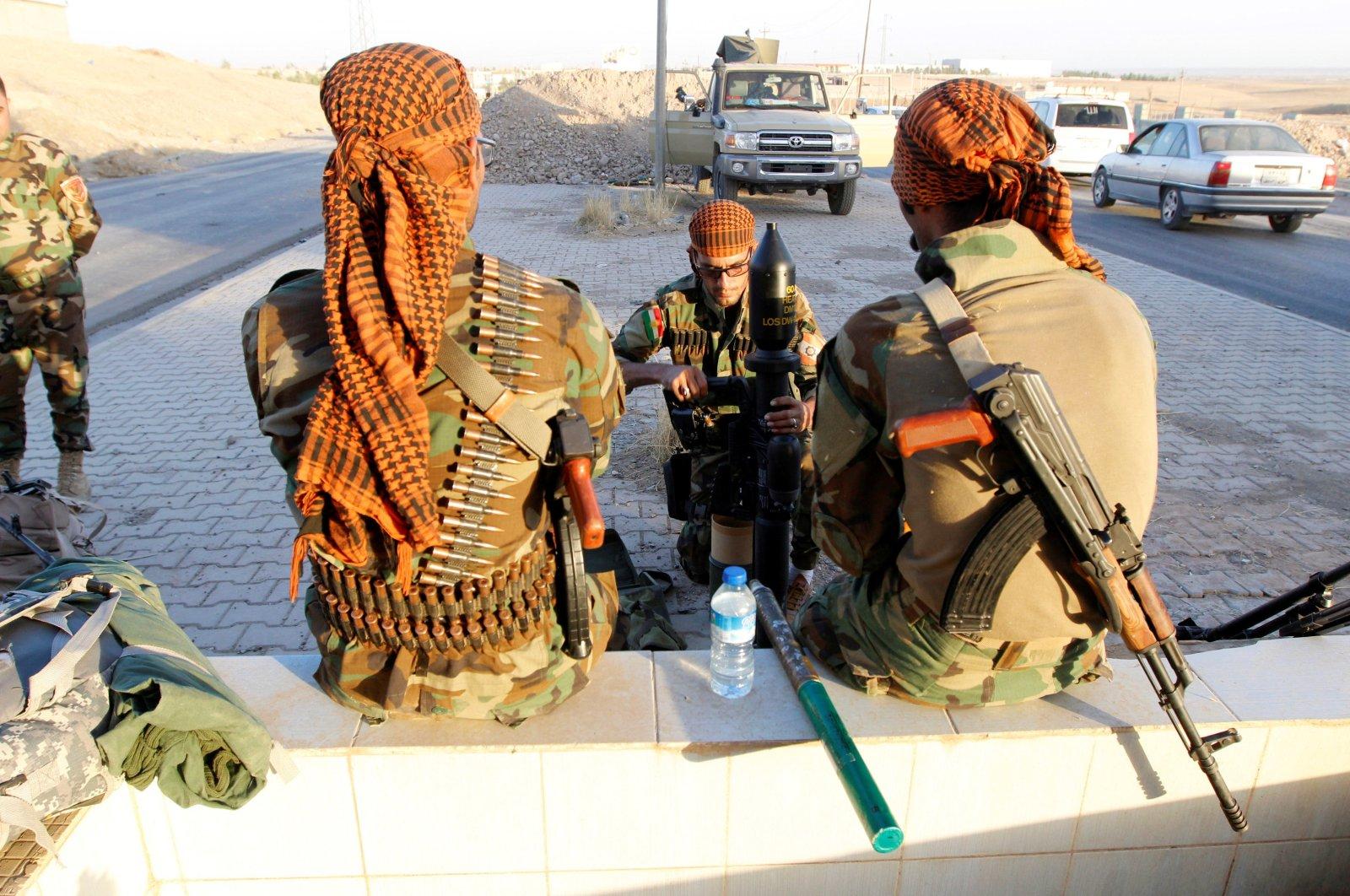 Kurdish Peshmerga fighters gather north of Kirkuk, Iraq, Oct. 19, 2017. (Reuters Photo)