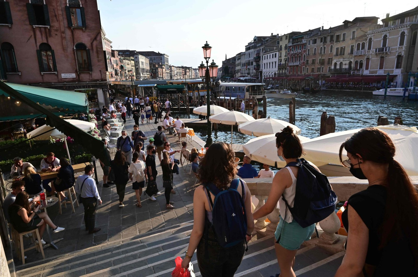 Tourists stroll alongside the Grand Canal in Venice, Italy, June 4, 2021. (Photo by Miguel Medina via AFP)