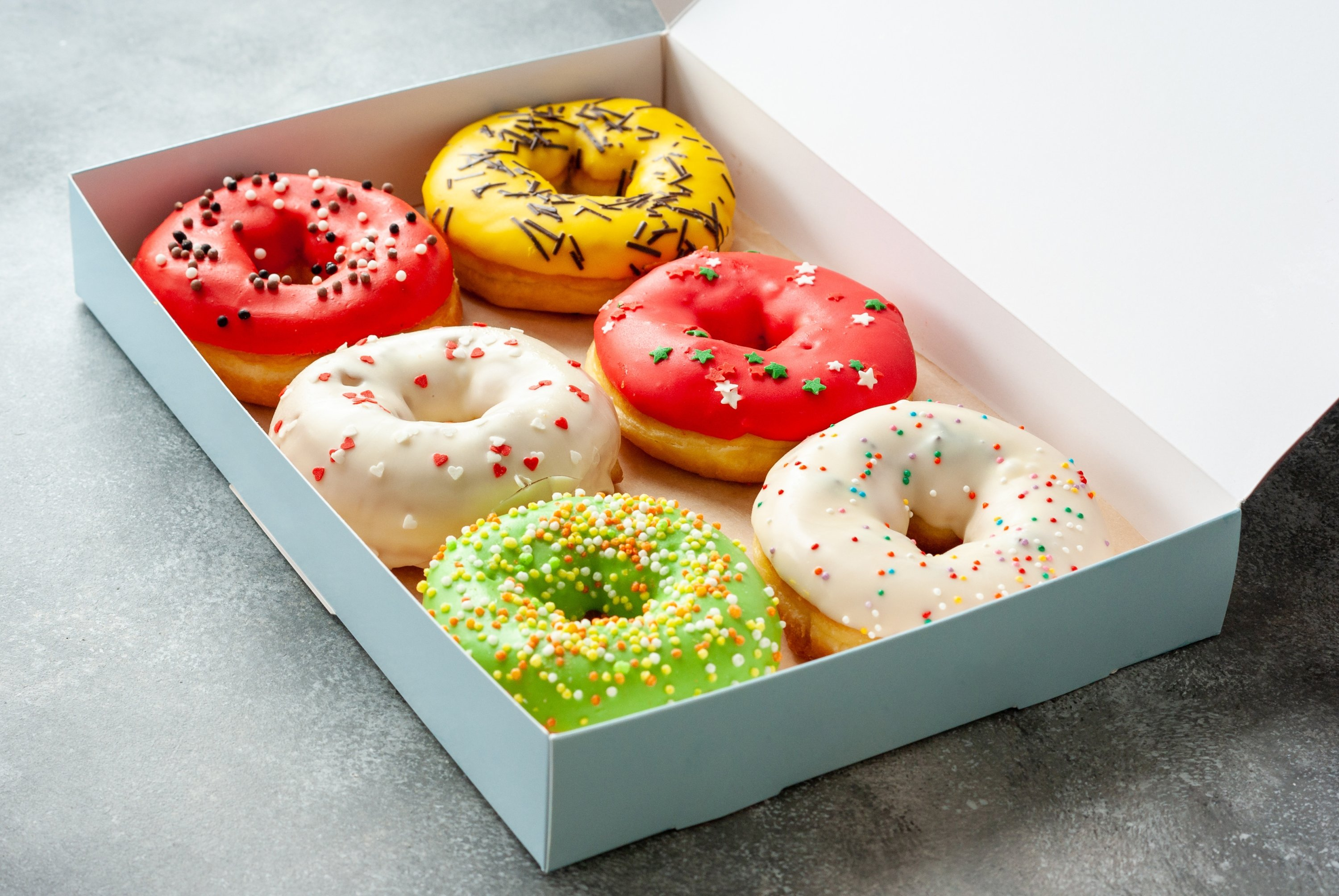 Assorted donuts in a box. (Shutterstock Photo)