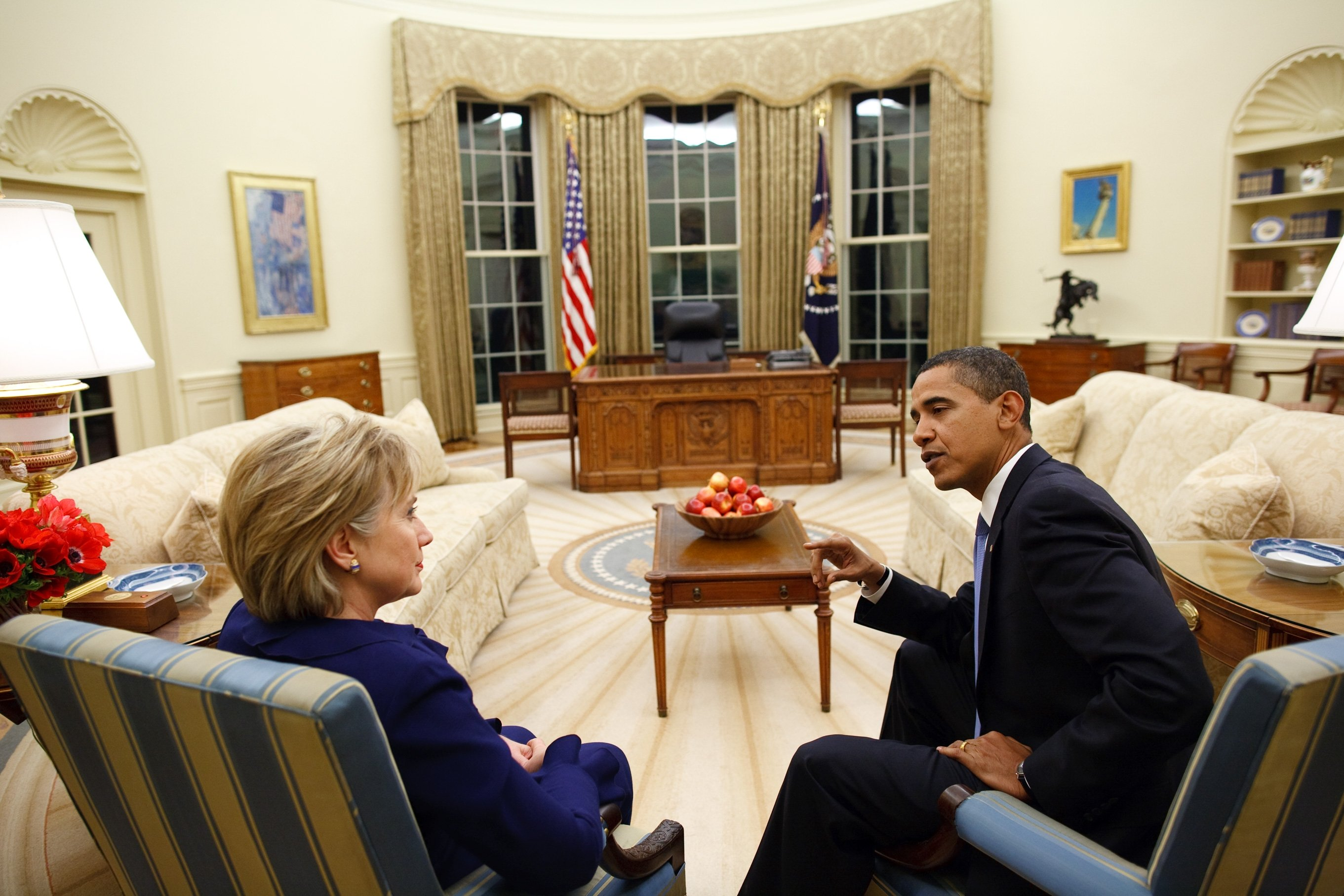 U.S. Secretary of State Hillary Clinton (L) talks with U.S. President Barack Obama shortly after she was confirmed and sworn in, Oval Office of the White House, Washington, D.C., U.S., Jan. 21, 2009. (Photo by Getty Images)