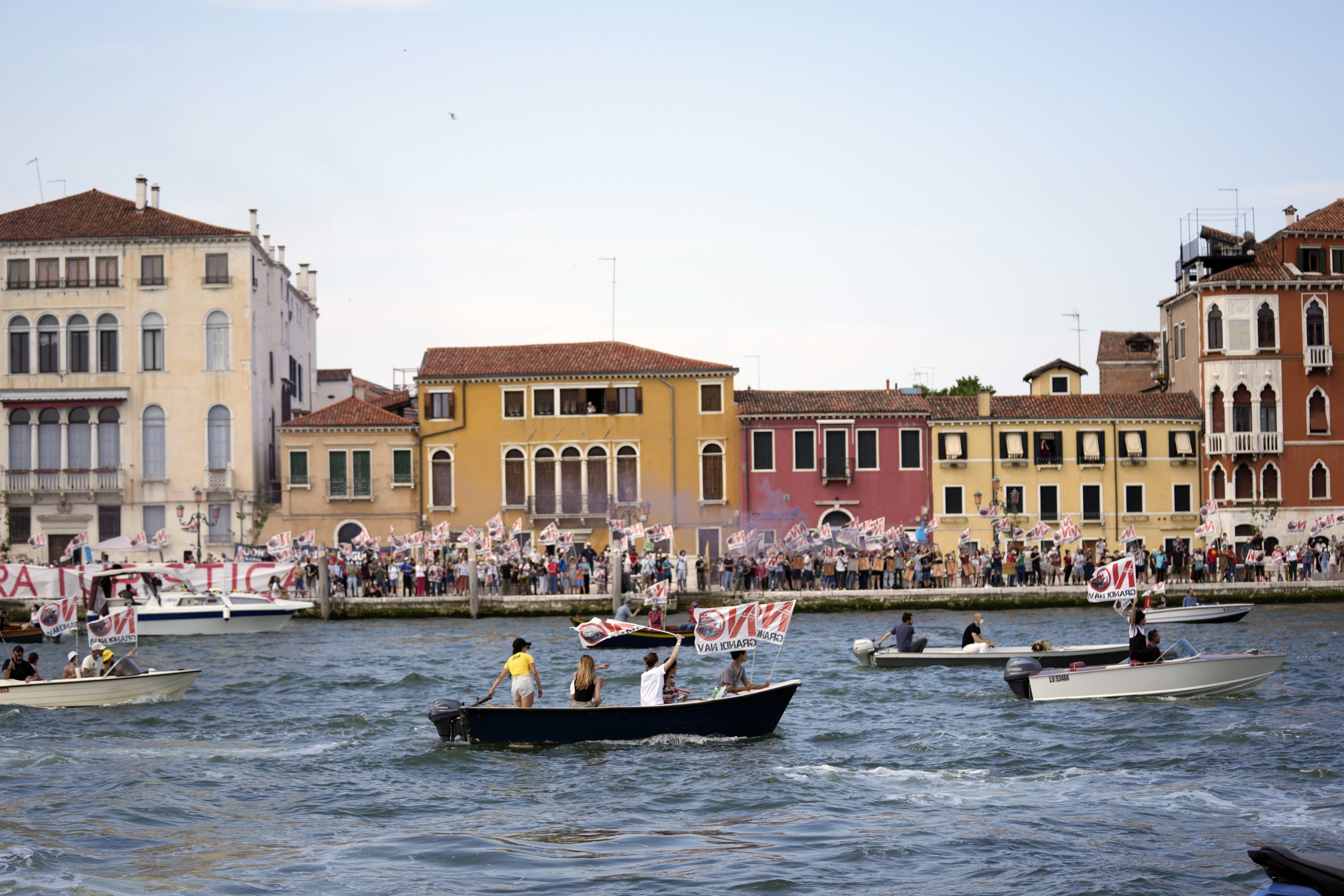 'No Big Ships' activists stage a protest as the MSC Orchestra cruise ship leaves Venice, Italy, June 5, 2021. (AP Photo)