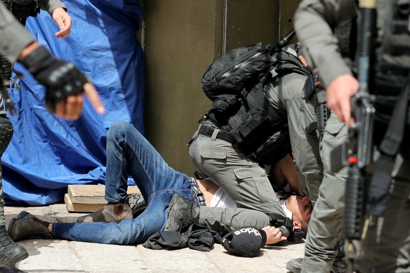 Israeli police detain a Palestinian during clashes at the compound that houses Al-Aqsa Mosque, in the Old City, East Jerusalem, occupied Palestine, May 10, 2021. (Reuters Photo)