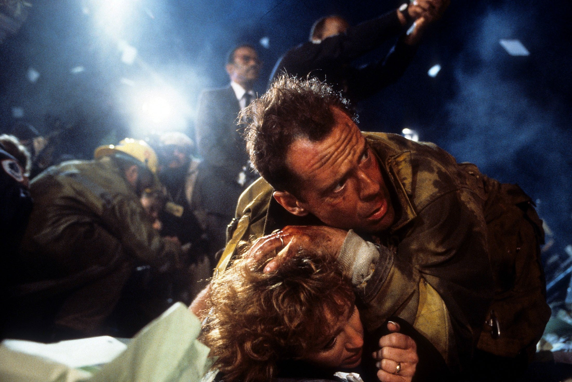 """Bruce Willis covers over Bonnie Bedelia, who playhusband andwife, in a scene from the film""""Die Hard"""", released in 1988. (Getty Images)"""
