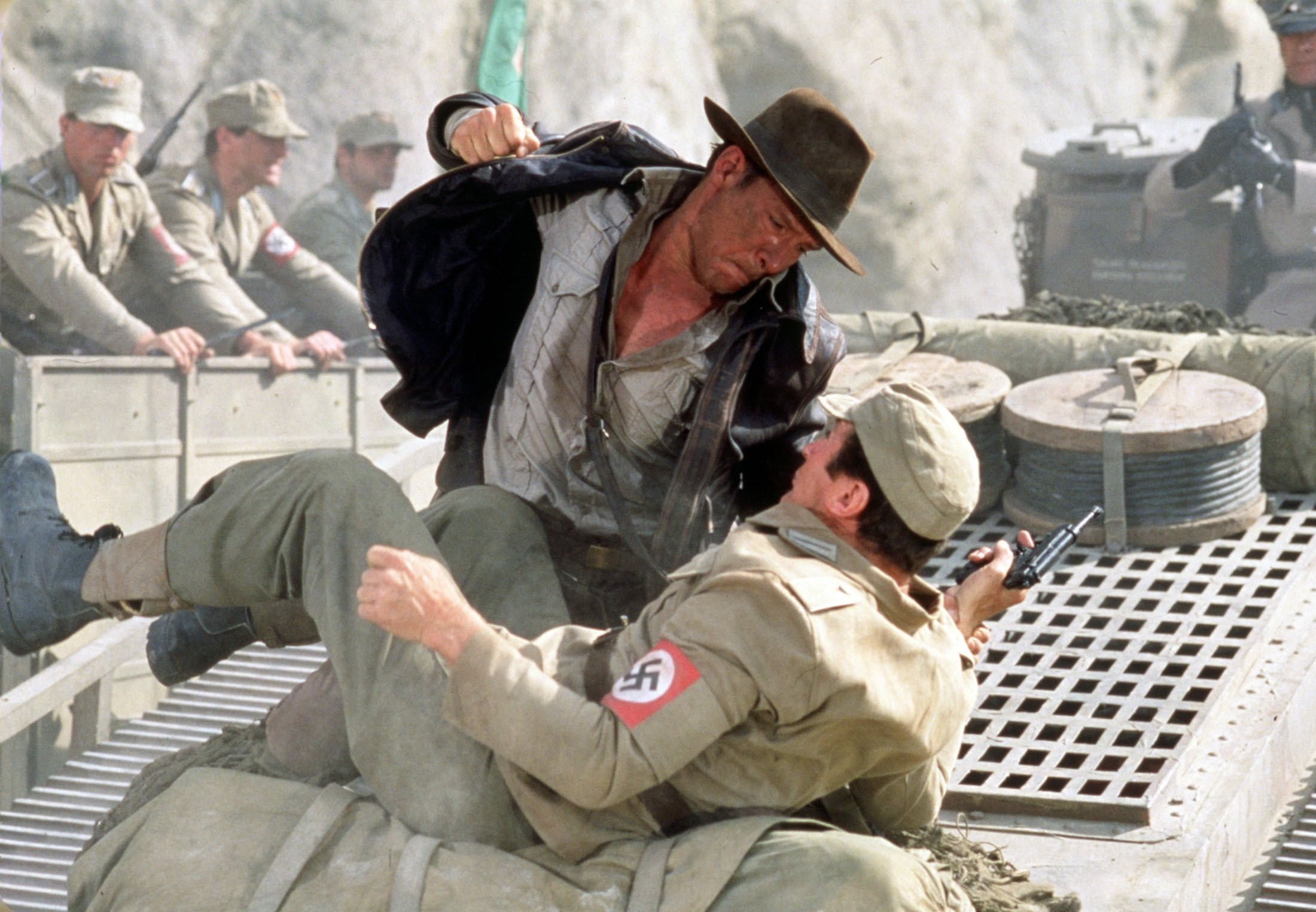 American actor Harrison Ford has a fistfight with a German soldier atop a moving tank in a scene from the film 'Indiana Jones and the Last Crusade', released in 1989. (Getty Images)
