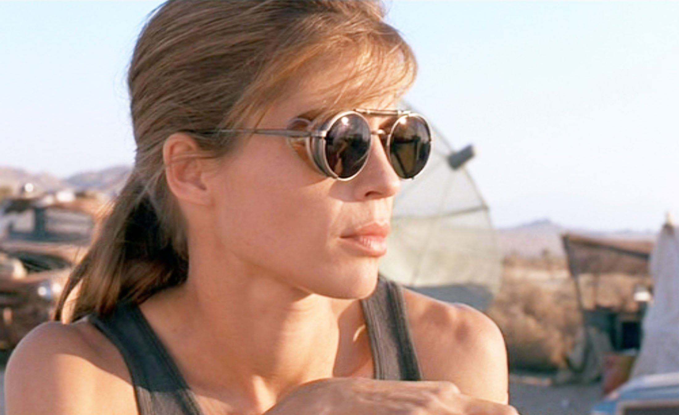 Linda Hamilton, playing Sarah Connor, wears black, round sunglasses in a scene from the movie 'Terminator 2: Judgement Day', released in 1991. (Getty Images)