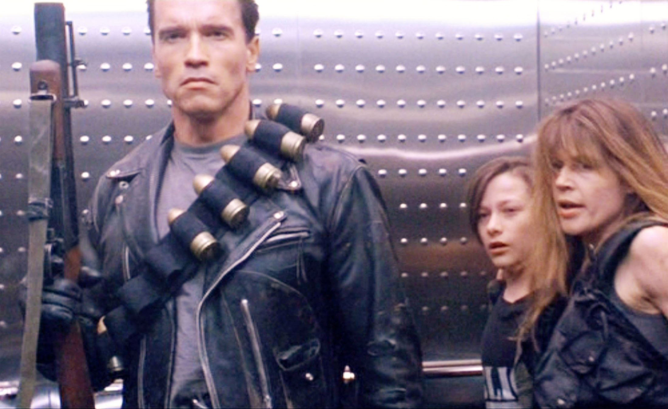 Arnold Schwarzenegger (L),Edward Furlong (C) and Linda Hamilton take the elevator in a scene from the movie'Terminator 2: Judgment Day', released in 1991. (Getty Images)