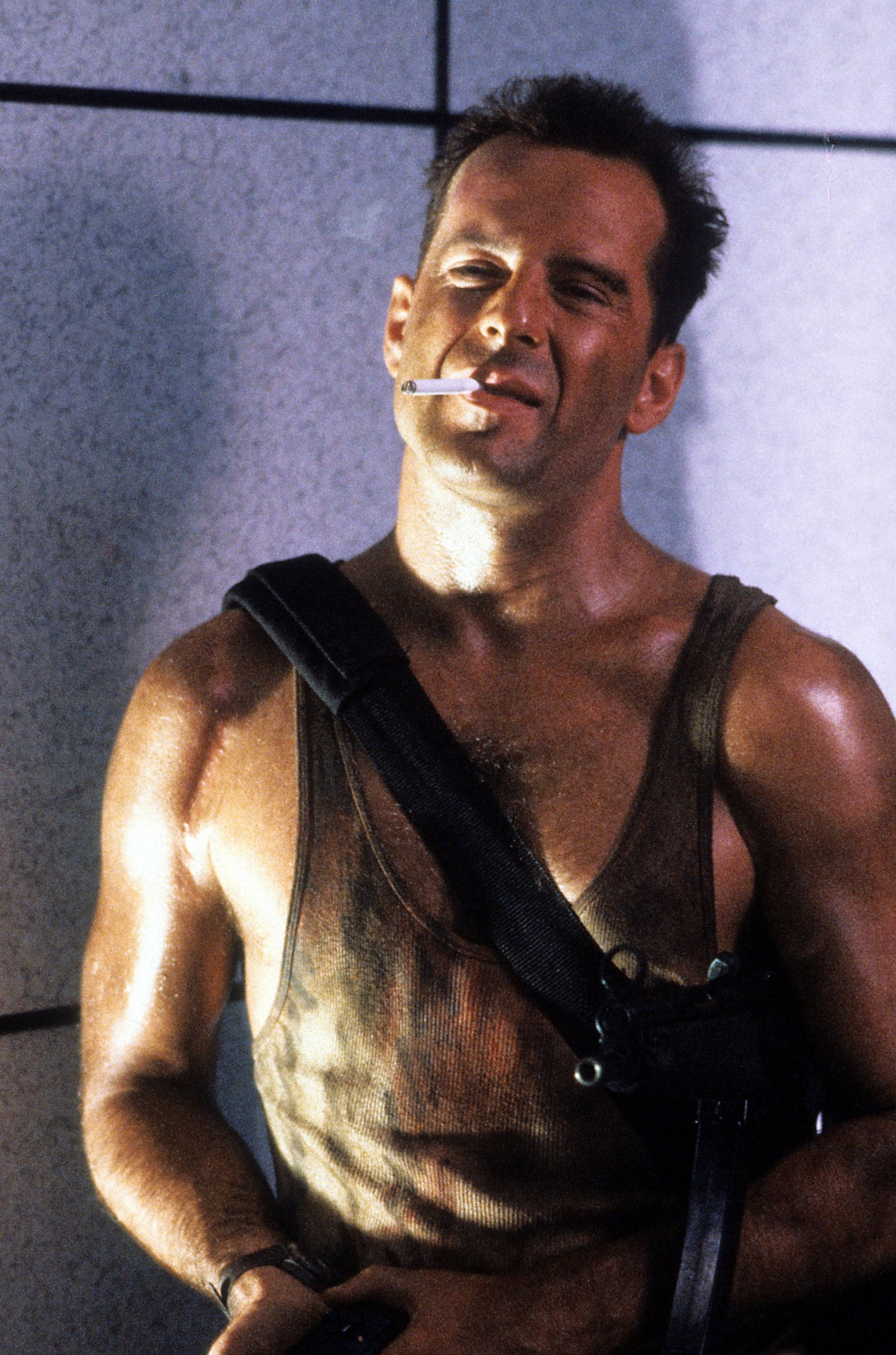 Bruce Willis smokes a cigarette in a scene from the film 'Die Hard', released in 1988. (Getty Images)