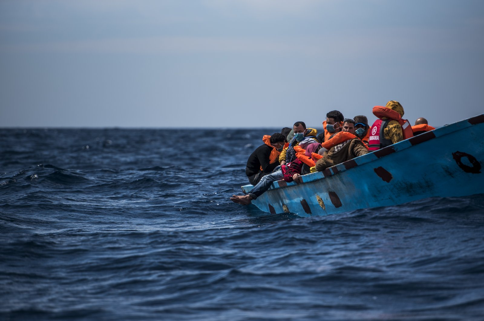 Before it was rescued by a nongovernmental organization in Barcelona, Spain, a wooden boat with 38 migrants of various nationalities, the majority of whom were Libyans, bobs in the Malta Search and Rescue (SAR) Zone, March 27, 2021. (Photo by Getty Images)