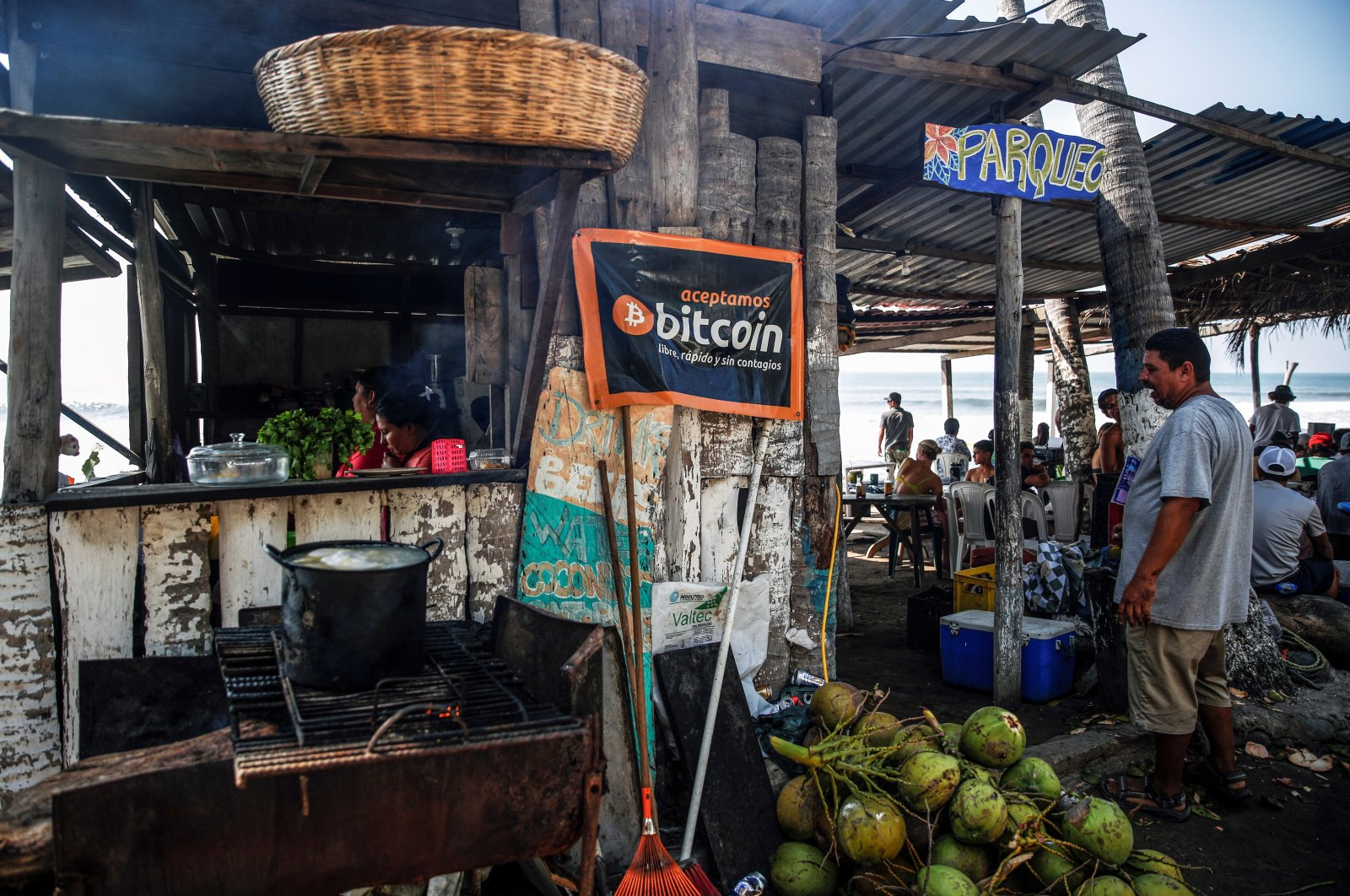 """A banner that reads """"We accept Bitcoin, free, fast and without contagion"""" is seen at a beach cafe on Punta Roca Beach in La Libertad, El Salvador, April 25, 2021. (Reuters Photo)"""