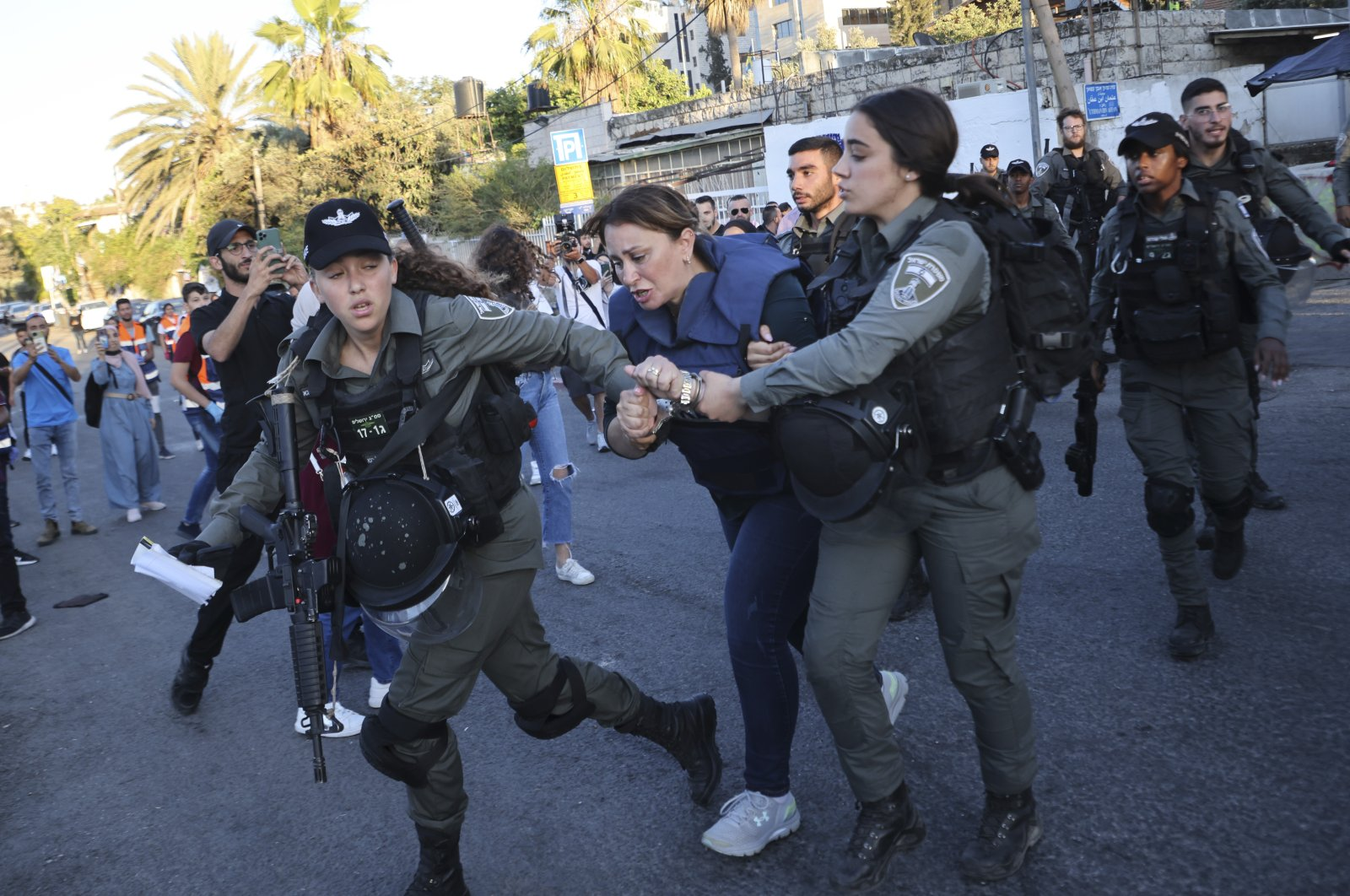 Israeli forces arrest Al Jazeera journalist Givara Budeiri during a protest in the Sheikh Jarrah neighborhood of East Jerusalem, occupied Palestine, Saturday, June 5, 2021. (AP Photo)