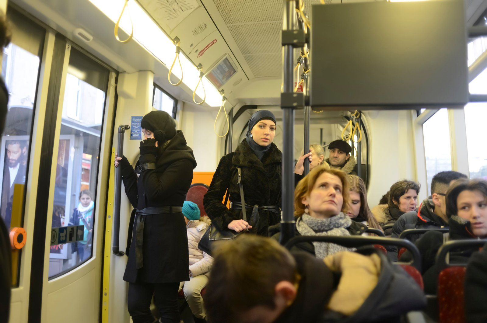 A Muslim woman looks at a camera while using public transportation, Vienna, Austria, March 12, 2013. (Shutterstock Photo)