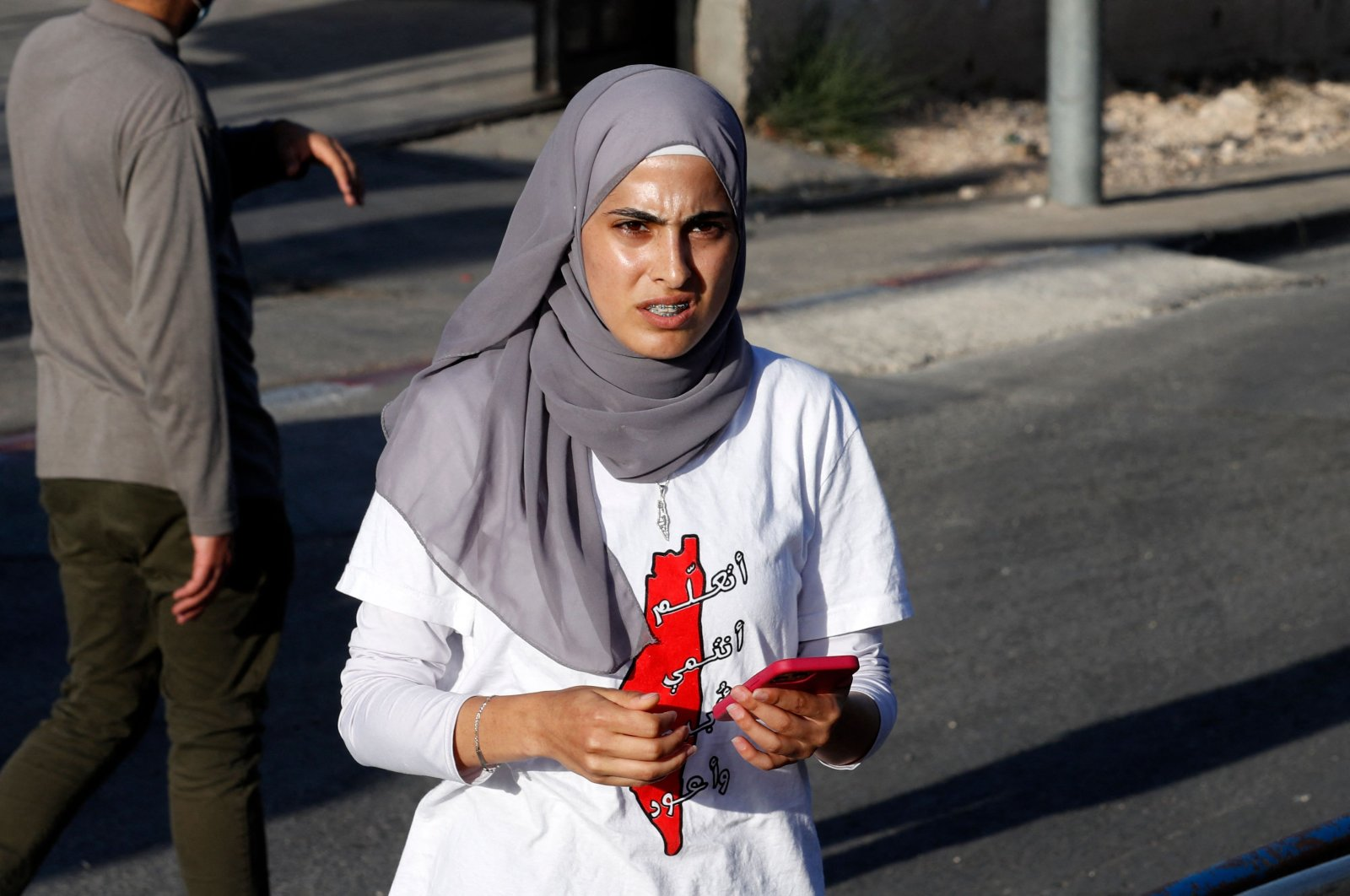 In this file photo taken on May 29, 2021, Palestinian activist Muna el-Kurd takes part in a rally to demand the reopening of the Israeli police checkpoint at the entrance of the Sheikh Jarrah neighborhood in occupied East Jerusalem, Palestine. (AFP Photo)