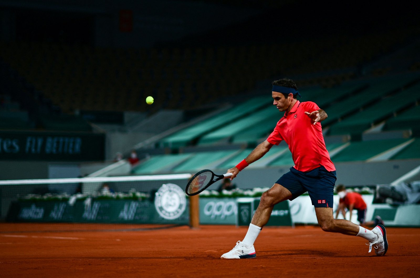 Switzerland's Roger Federer returns the ball to Germany's Dominik Koepfer during their French Open third-round match at the Roland Garros, Paris, France, June 5, 2021. (AFP Photo)