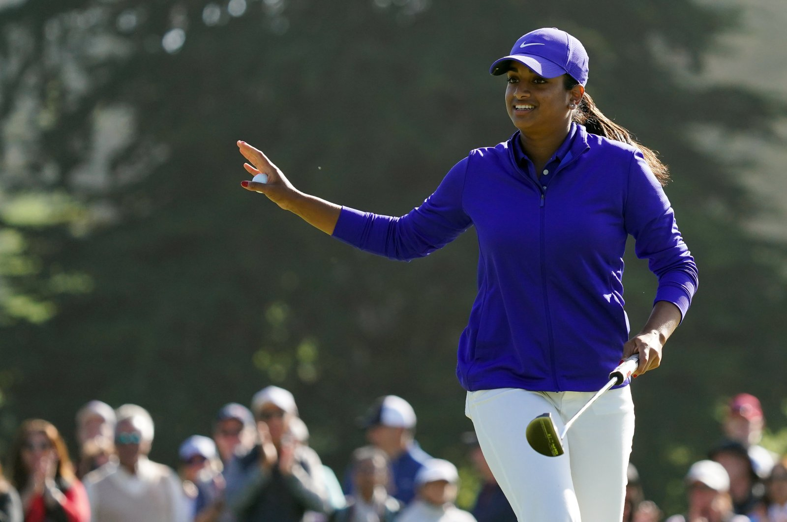 Megha Ganne waves to the gallery after putting out on the 14th green during the third round of the U.S. Women's Open golf tournament at The Olympic Club, San Francisco, California, U.S., Jun 5, 2021. (Reuters Photo)