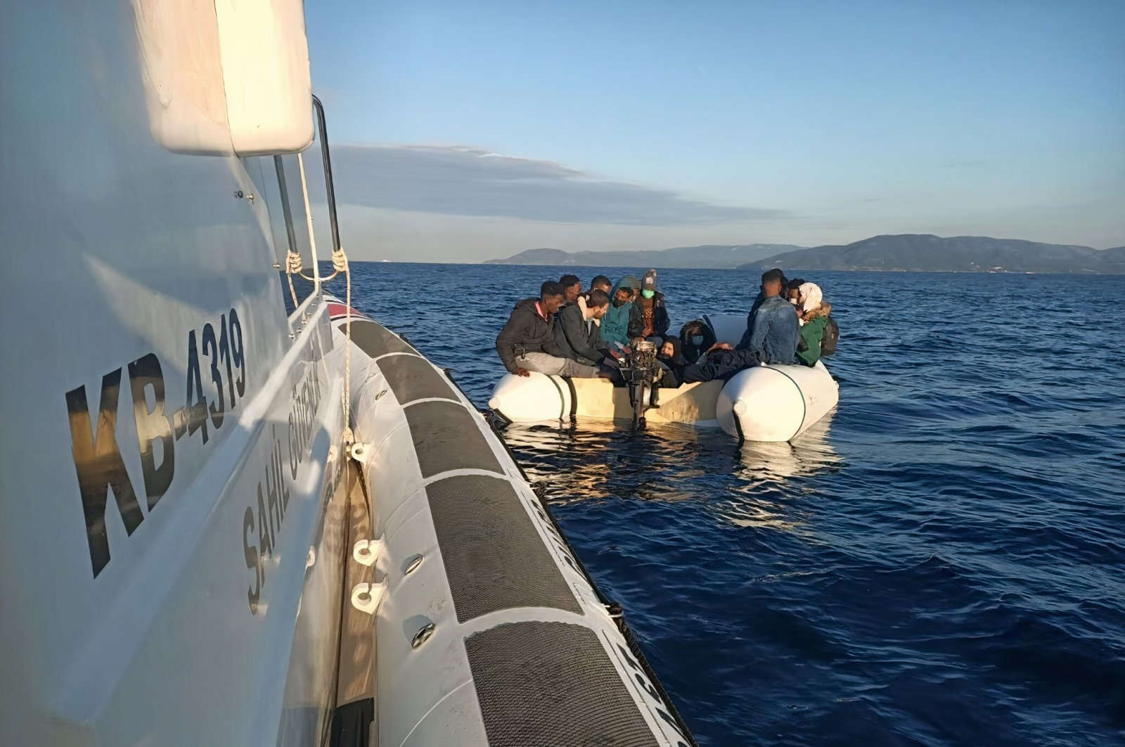 Seventeen irregular migrants pushed back by Greece are rescued by the Turkish coast guard off western Izmir province's Dikili, Turkey, June 5, 2021 (DHA Photo)