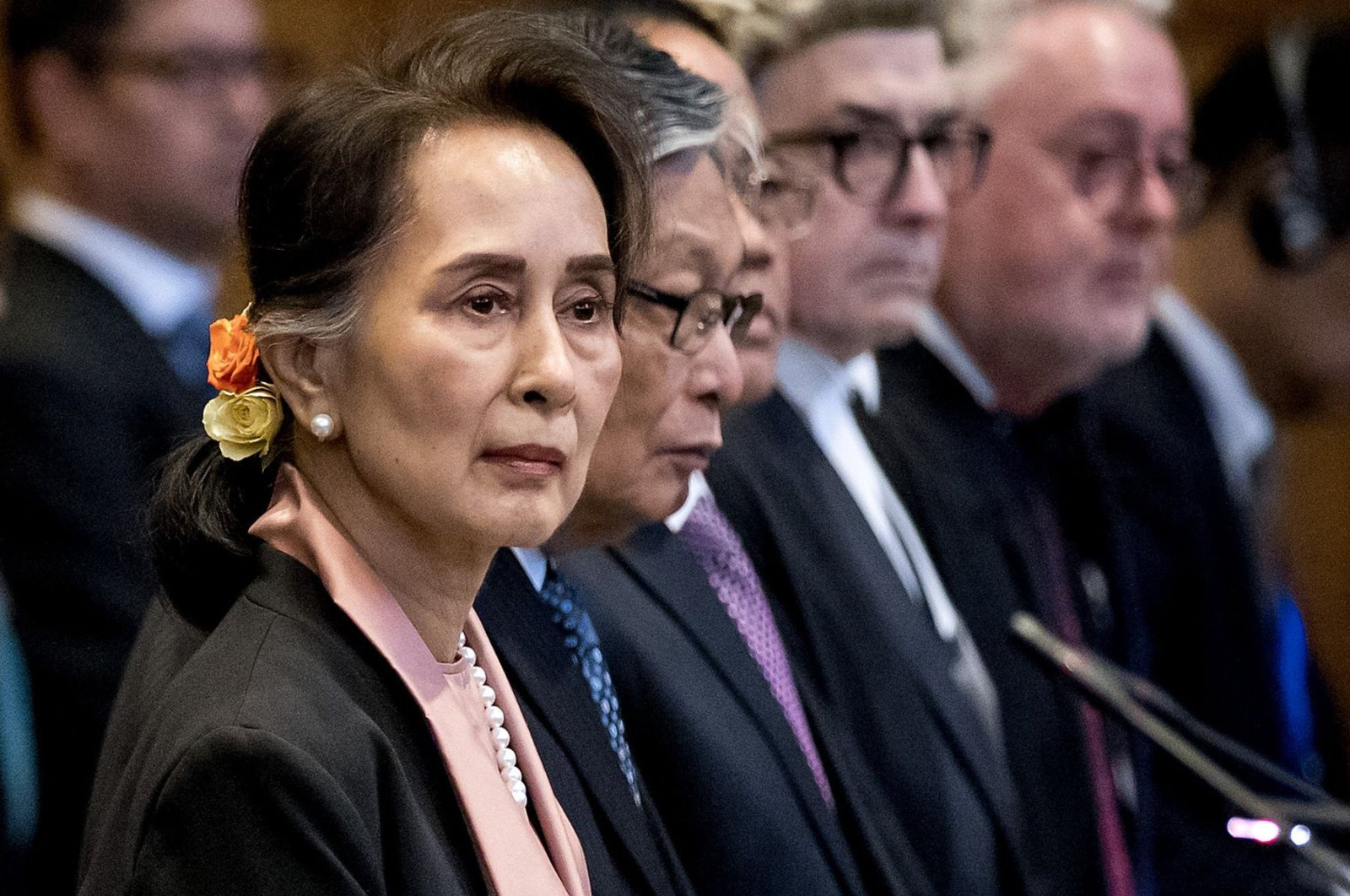 Myanmar's State Counselor Aung San Suu Kyi (L) stands before U.N.'s International Court of Justice at the start of a three-day hearing on the Rohingya genocide case at the Peace Palace, The Hague, the Netherlands, Dec. 10, 2019. (AFP Photo)