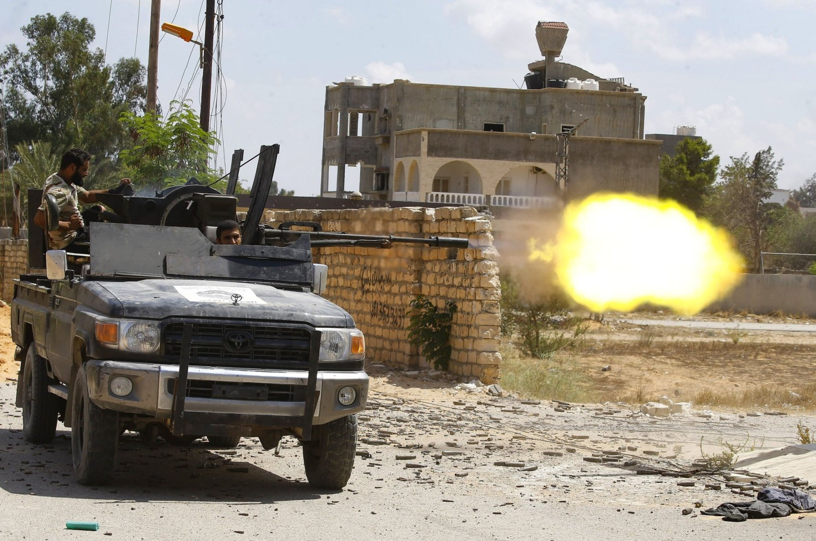 A fighter loyal to the internationally-recognized Libyan Government of National Accord (GNA) fires a truck-mounted gun during clashes with forces loyal to putschist Gen. Khalifa Haftar in the capital Tripoli's suburb of Ain Zara, Sept. 7, 2019. (AFP File Photo)