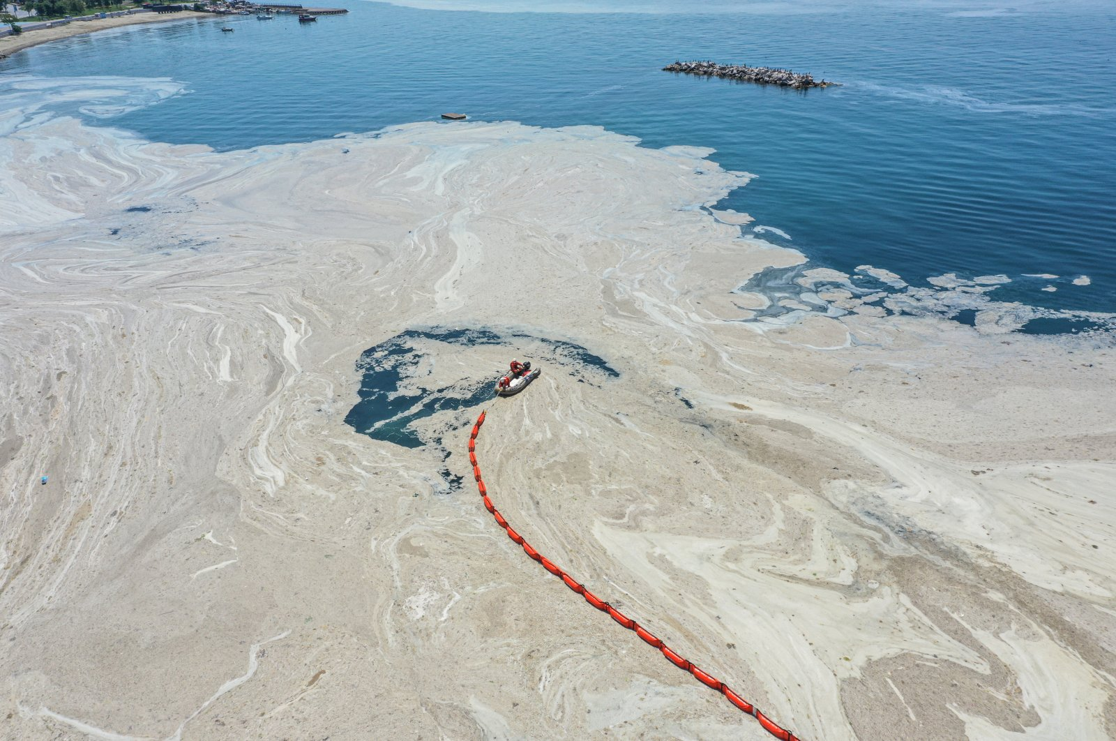 """An aerial view of """"sea snot"""" off the coast of Kadıköy, in Istanbul, Turkey, June 6, 2021. (AA PHOTO)"""