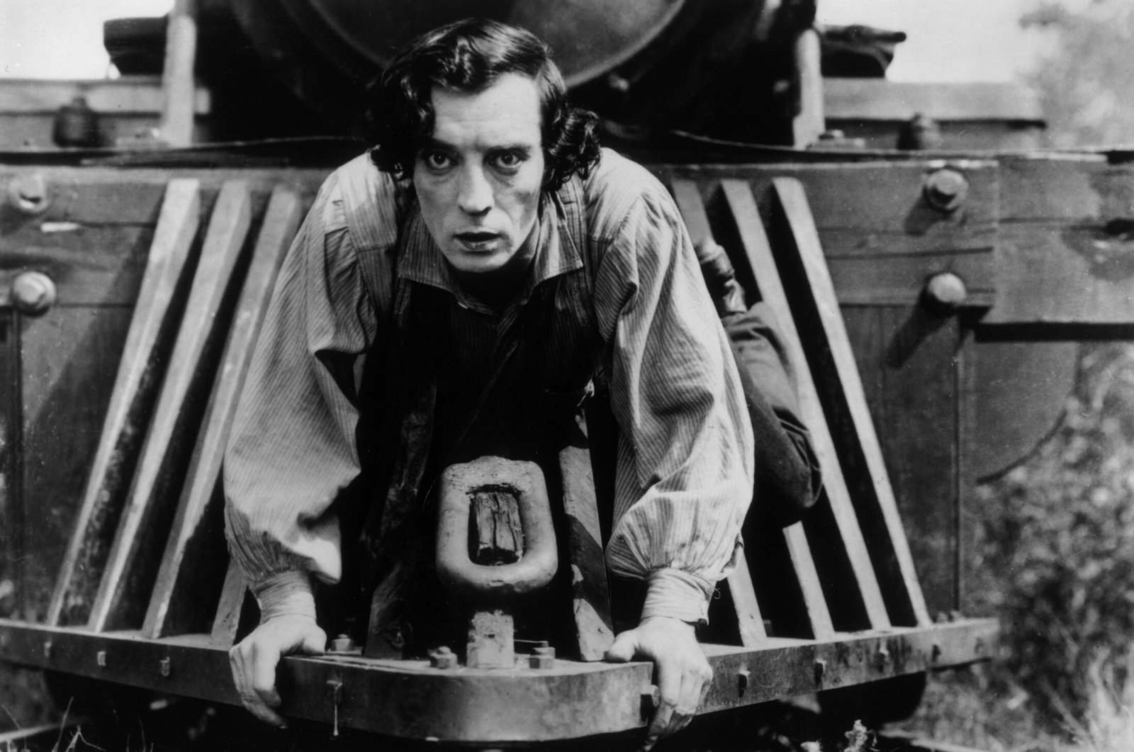 """American actor Buster Keaton clinging to the front of a train in a still from the film, """"The General,"""" directed by Keaton and Clyde Bruckman, released in 1926.  (Getty Images)"""