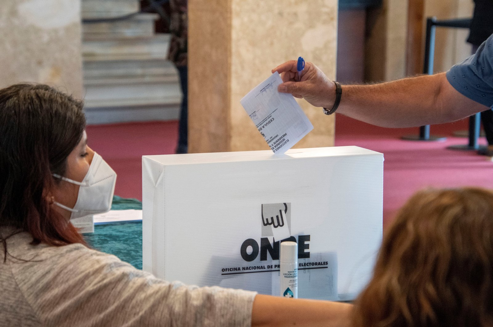 Peruvian residents in Spain cast ballots at Auditorium in Palma, Majorca, Spain, in order to vote for the second round of the Presidential elections in Peru, June 06, 2021. (EPA Photo)