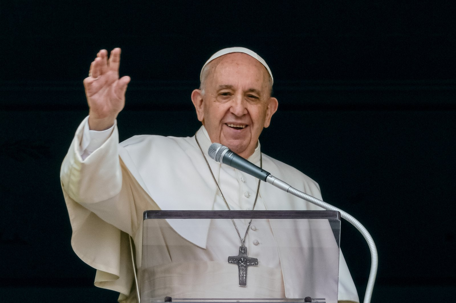 Pope Francis waves from the window of his studio overlooking St. Peter's Square at The Vatican to a crowd of faithful and pilgrims gathered for the Sunday Angelus noon prayer, Rome, Italy, June 6, 2021. (AP Photo)