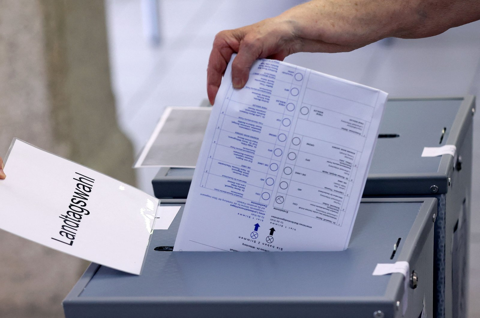 A voter casts his ballot for state elections in Saxony-Anhalt at a polling station on June 6, 2021, in Wittenberg, eastern Germany. (AFP Photo)
