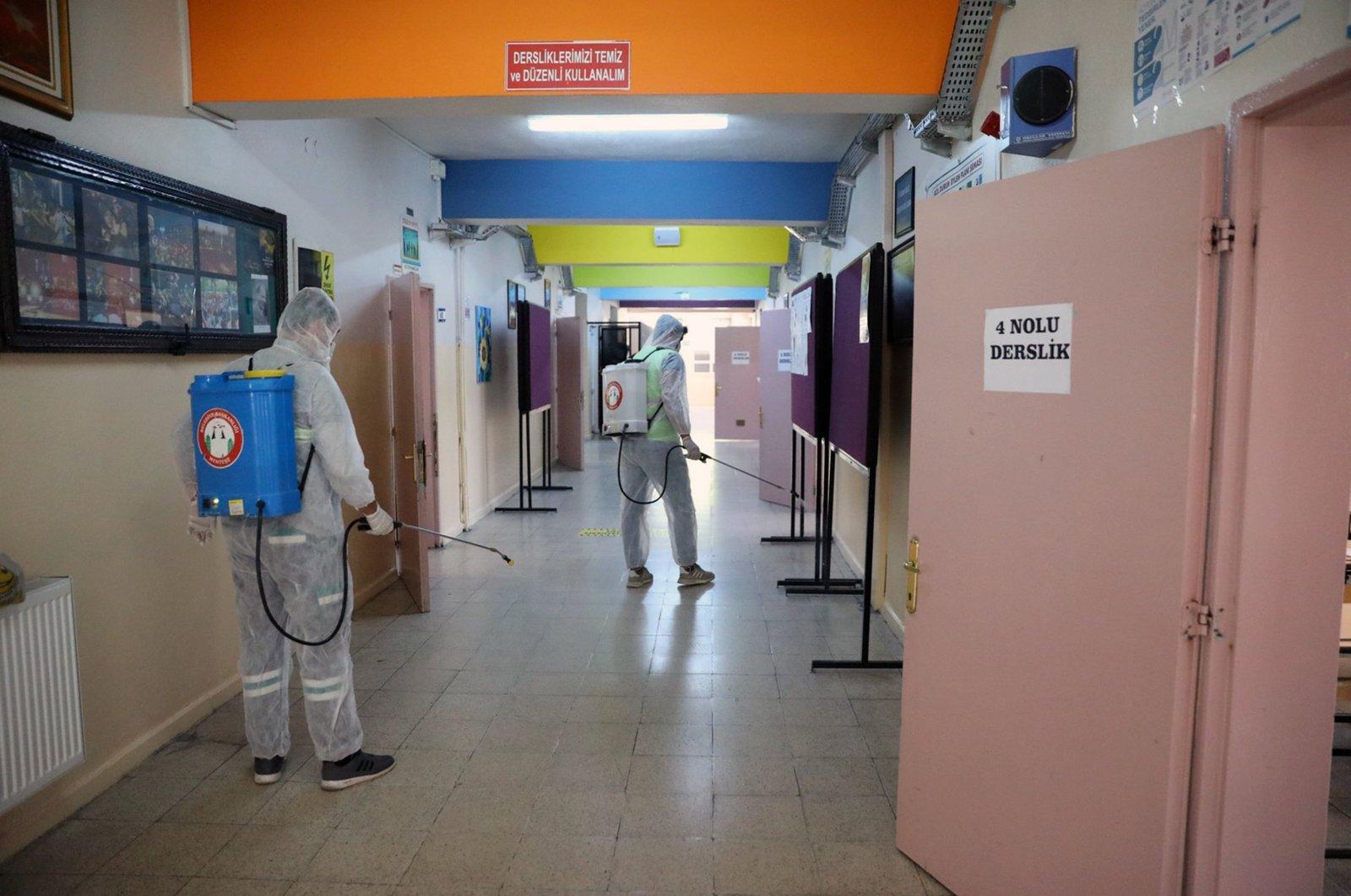 Municipal workers disinfect school before nationwide high school entrance exam in Menteşe district, Muğla, Turkey, June 6, 2021. (IHA Photo)